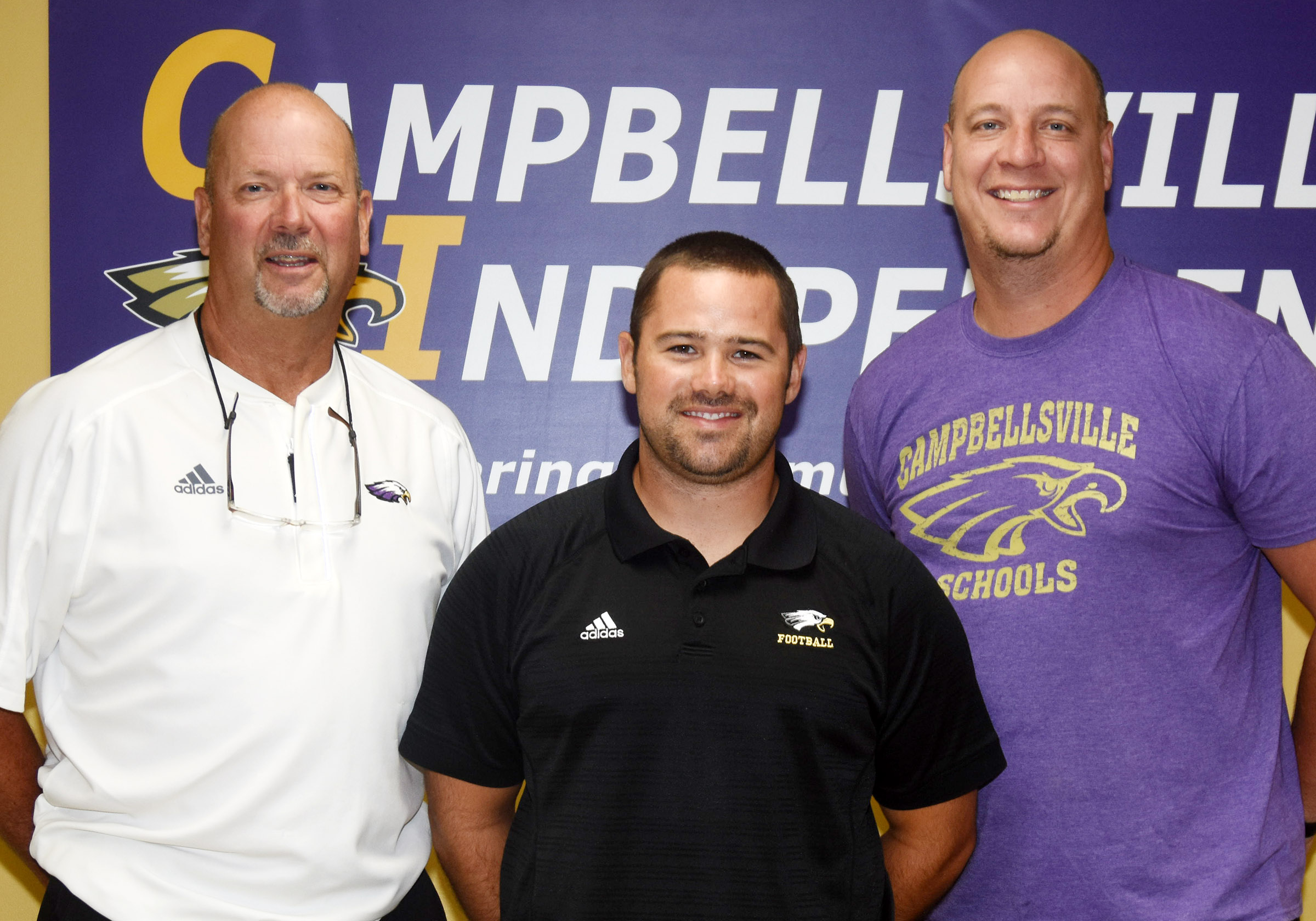 Blake Milby, who teaches social studies at Campbellsville High School and is also head baseball coach, has been hired for the CHS golf coach post. Pictured with him are CHS Athletic Director Tim Davis, at left, and CHS Principal David Petett.