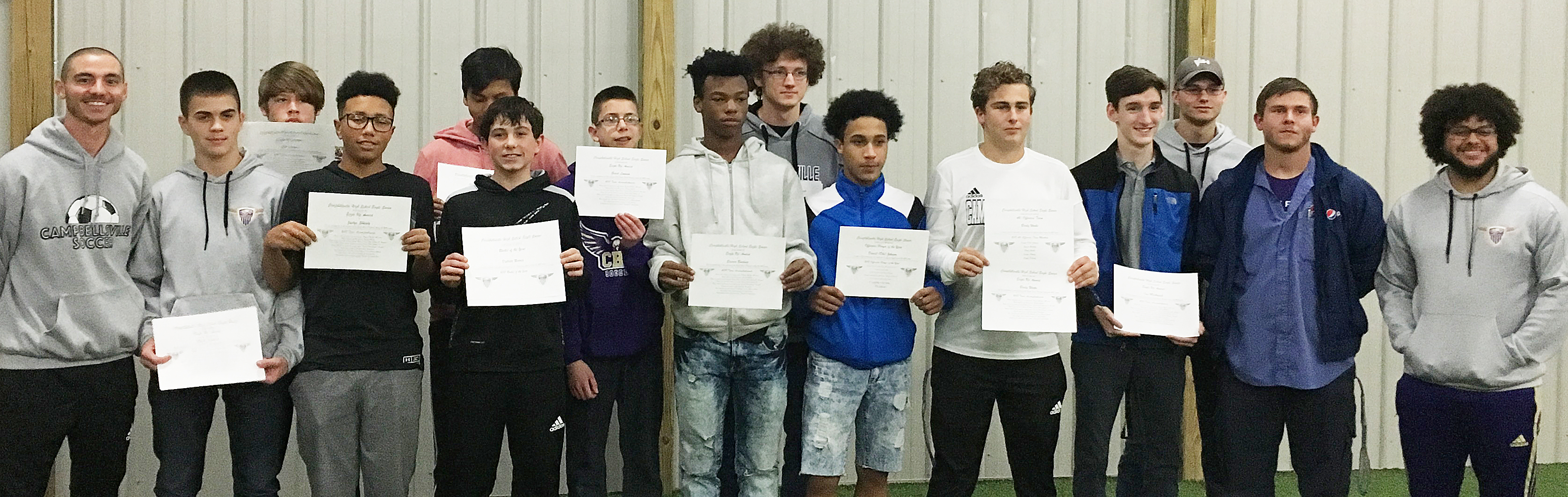 CHS soccer players are honored with the Eagle Up award. From left are head coach Bradley Harris, sophomore Clark Kidwell, freshman Josh Lucas, sophomores Jastyn Shively and Jeffrey Sustaita, freshmen Dakota Harris and Grant Lawson, sophomore Sae'von Buckner, junior Brennon Wheeler, seniors Daniel Johnson, Brody Weeks, Ian McAninch and Keidlan Boils and assistant coaches Owen Weeks and Malique Spaulding. Absent from the photos are freshmen Jarred Mays and Peyton Dabney and senior Evan McAninch.