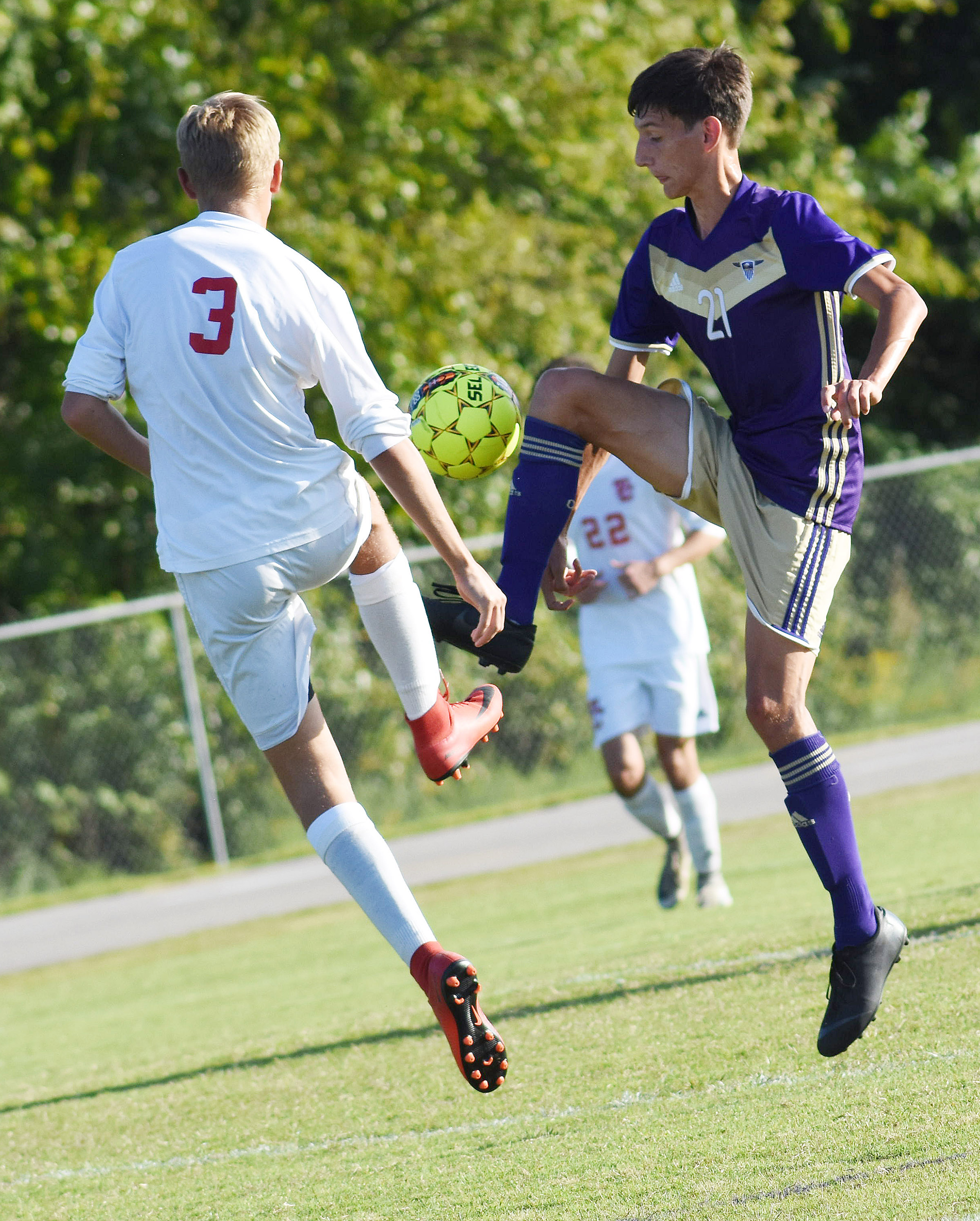 CHS senior Evan McAninch fights for the ball.