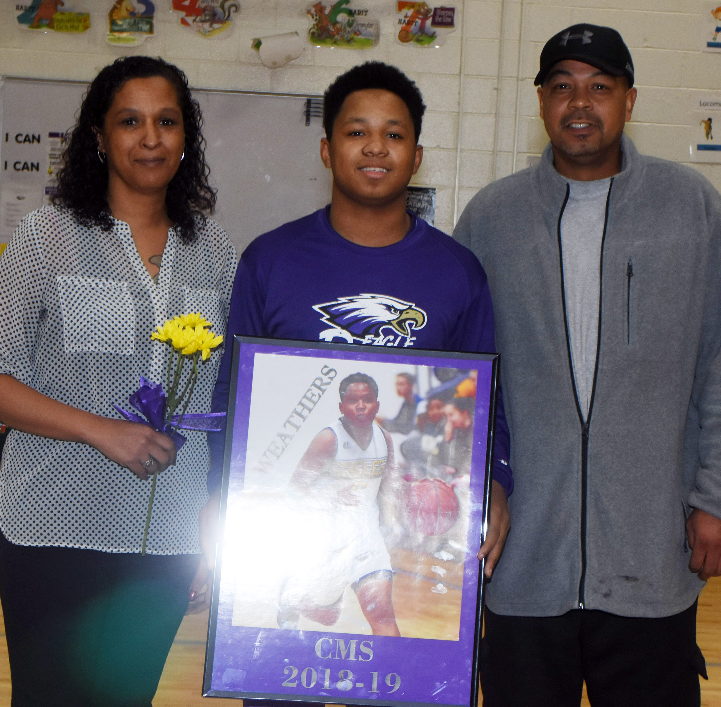 CMS boys' basketball eighth-grader player Deondre Weathers is honored.
