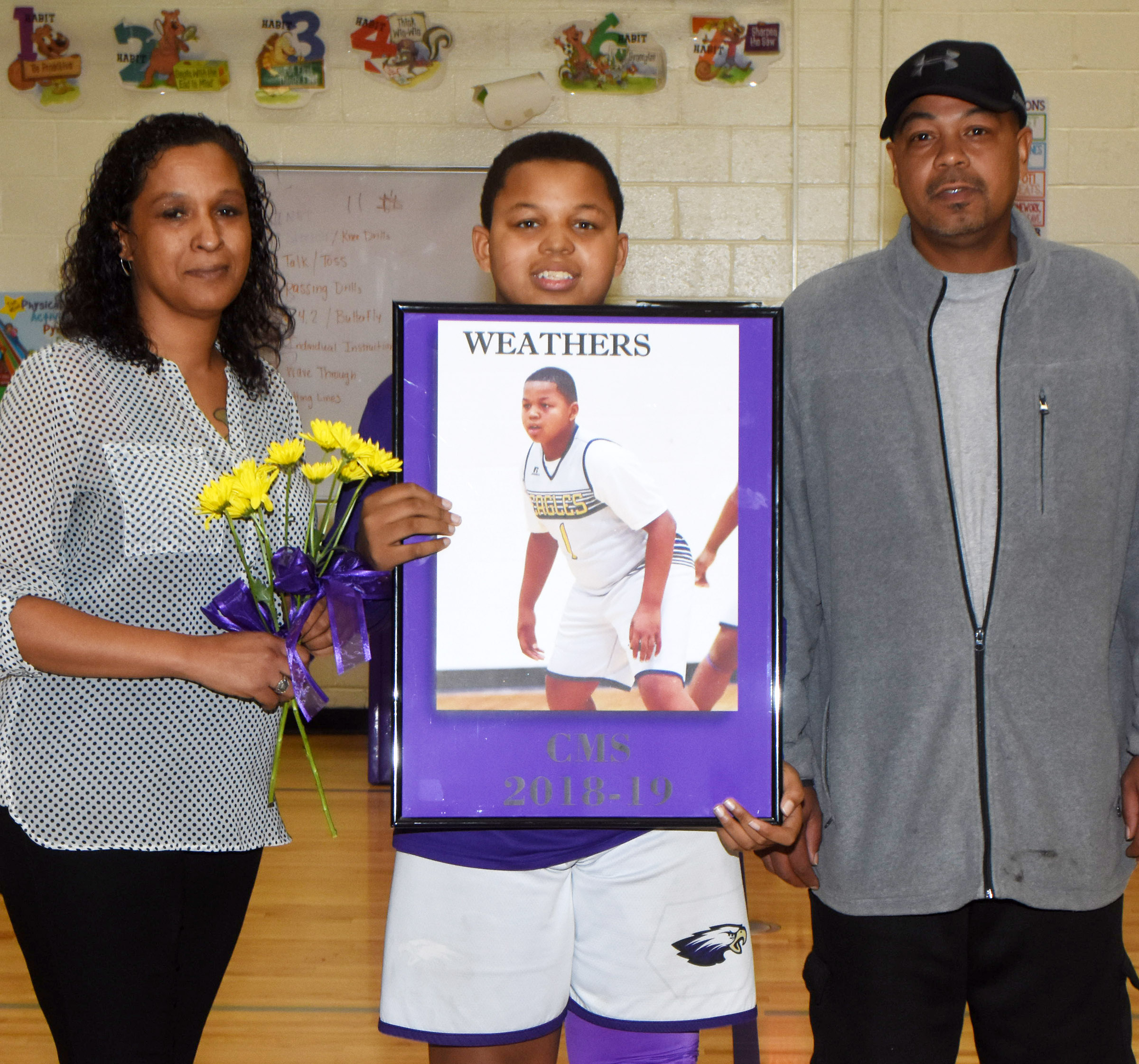 CMS boys' basketball eighth-grader player Keondre Weathers is honored.