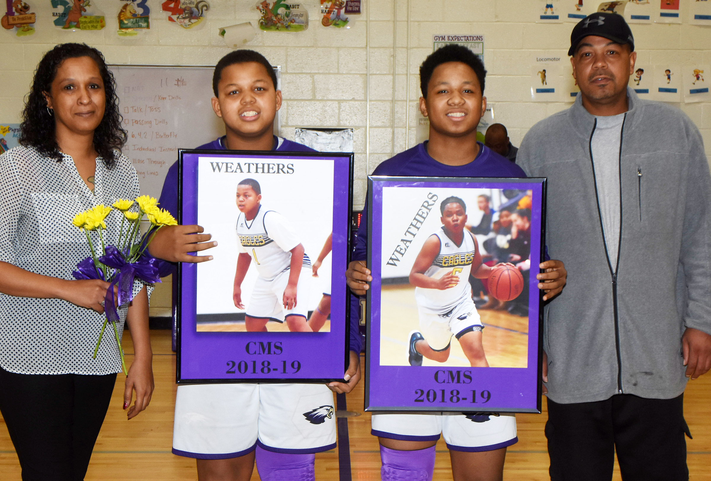 CMS boys' basketball eighth-grader players Keondre Weathers, at left, and Deondre Weathers are honored.