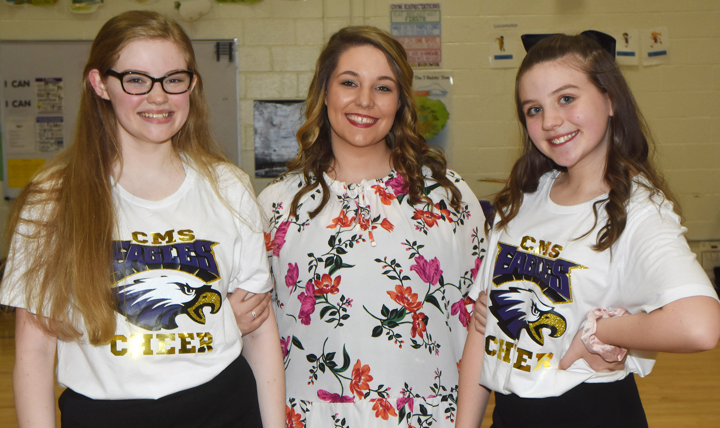 CMS eighth-grade cheerleaders are honored for their dedication and commitment to their squad. From left are Whitney Frashure sponsor Ashleigh Lewis and Mikaela Scharbrough.