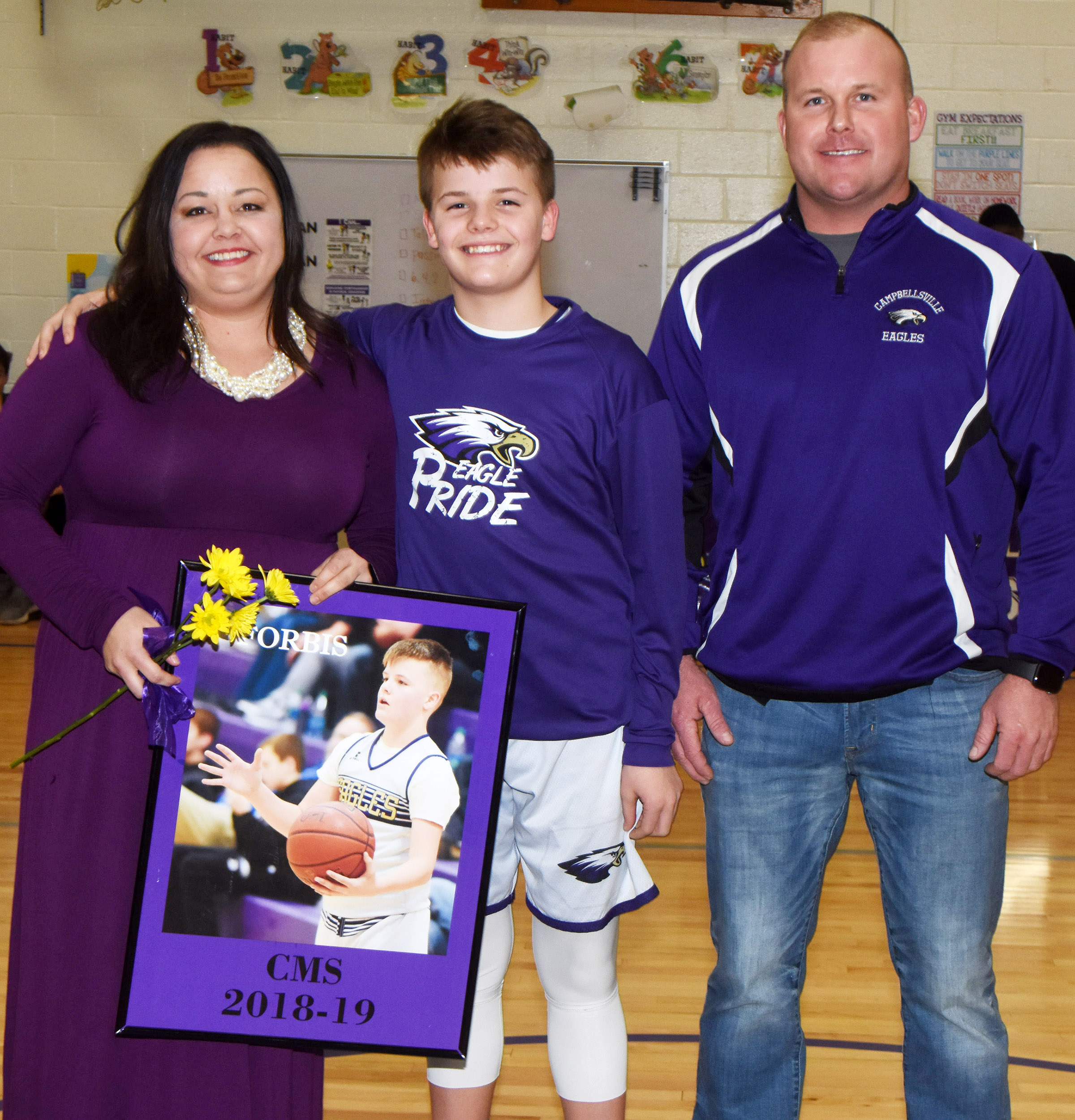 CMS boys' basketball eighth-grader player Konner Forbis is honored.