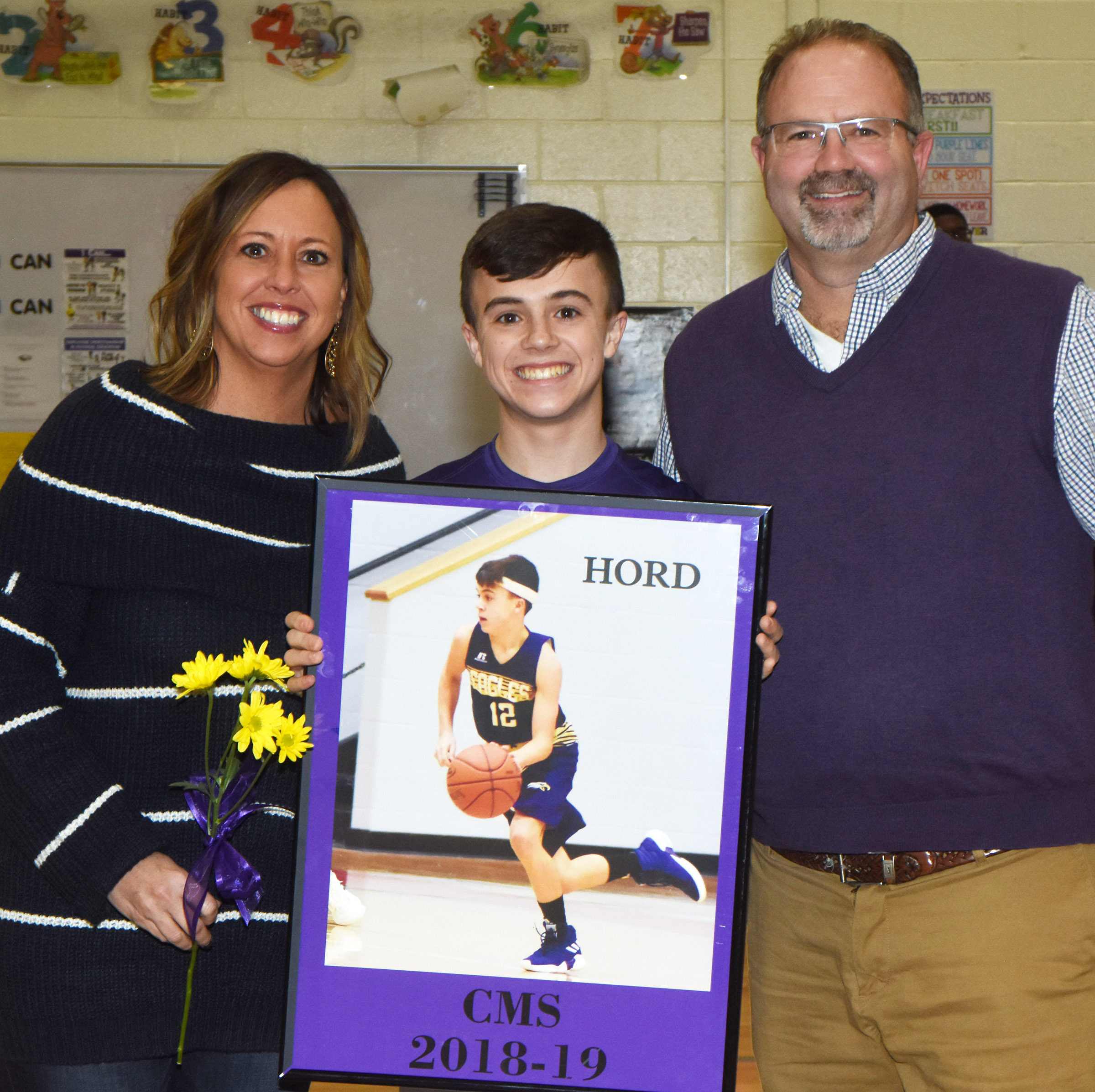 CMS boys' basketball eighth-grader player Chase Hord is honored.