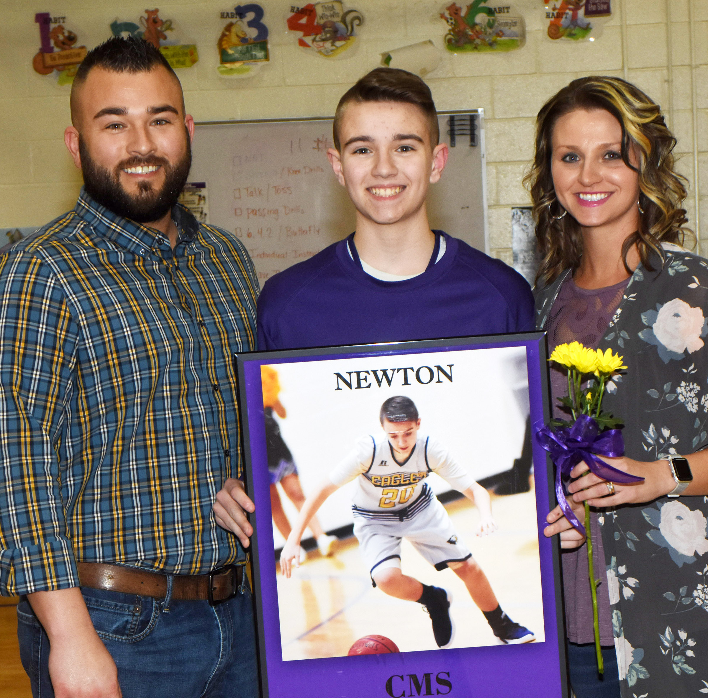 CMS boys' basketball eighth-grader player Bryce Newton is honored.