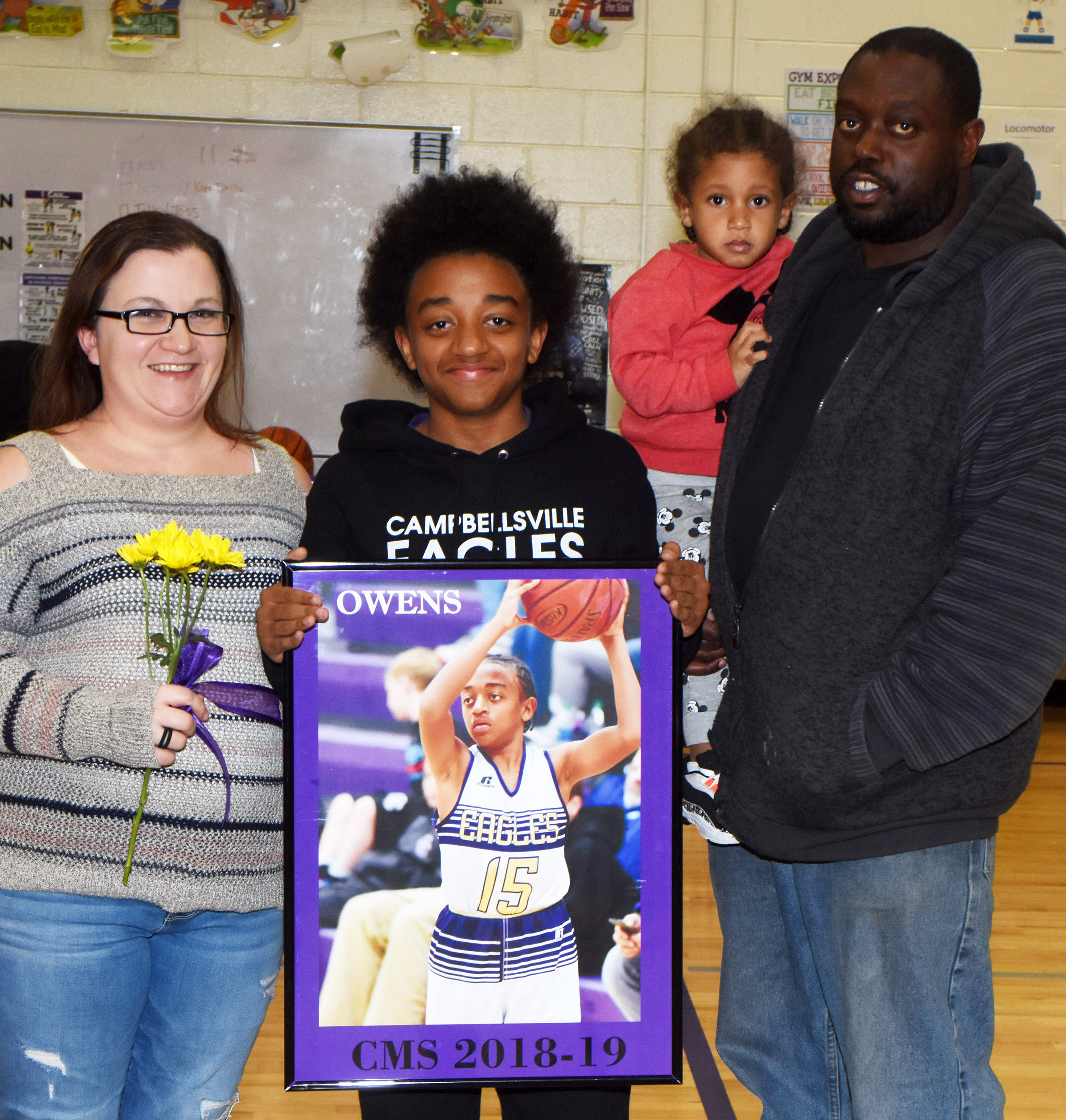 CMS boys' basketball eighth-grader player Zamar Owens is honored.
