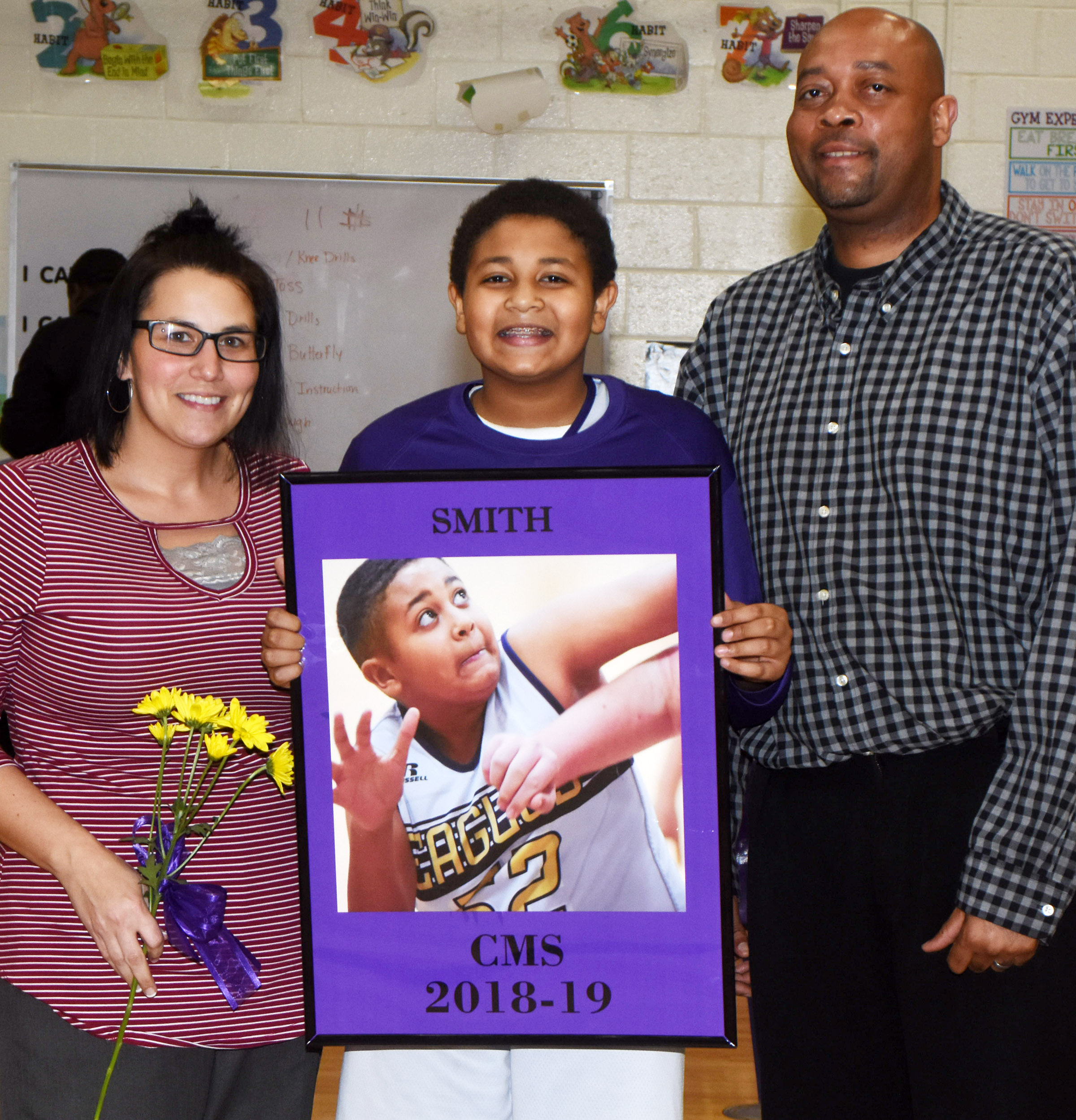CMS boys' basketball eighth-grader player Ronin Smith is honored.