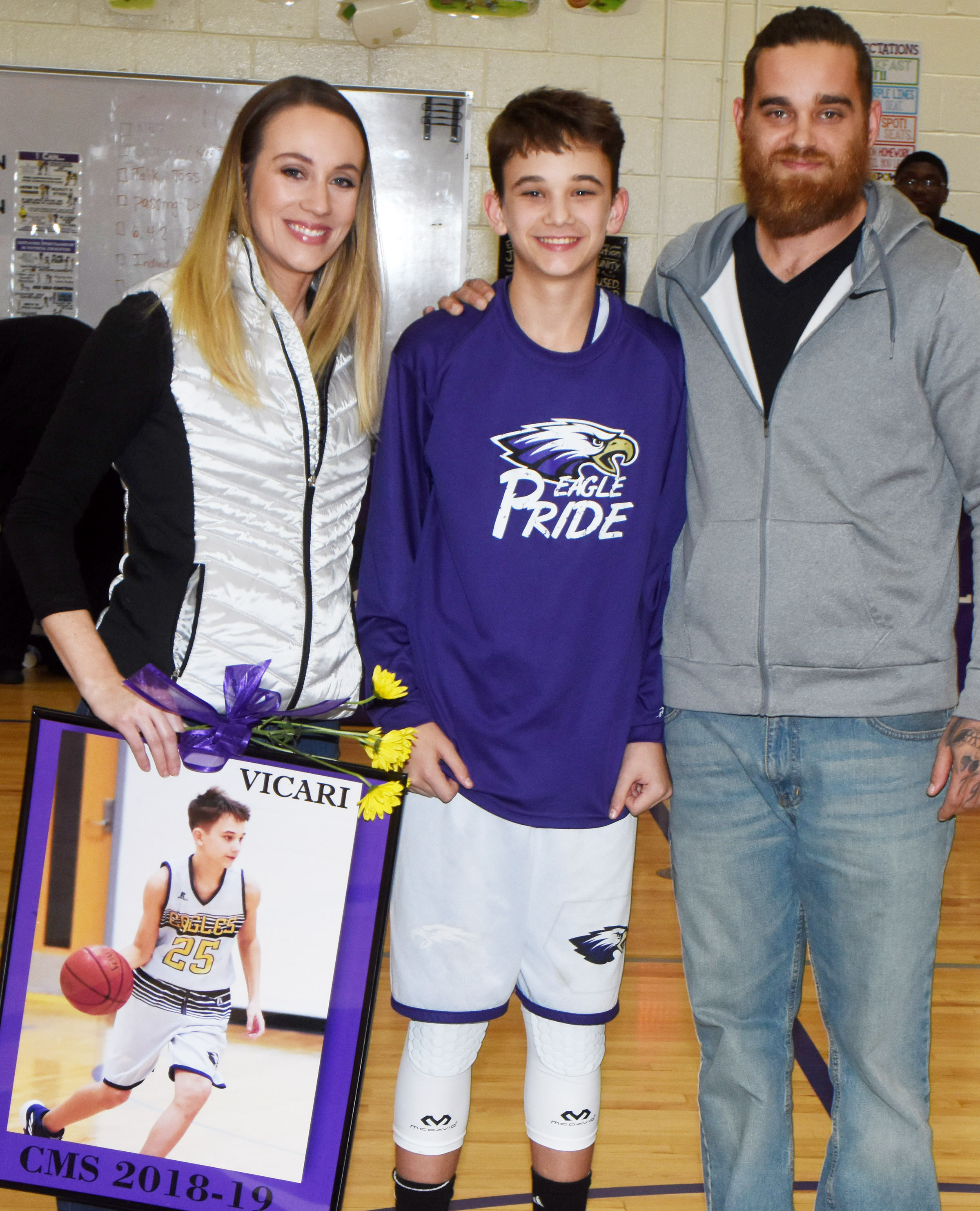 CMS boys' basketball eighth-grader player Camren Vicari is honored.
