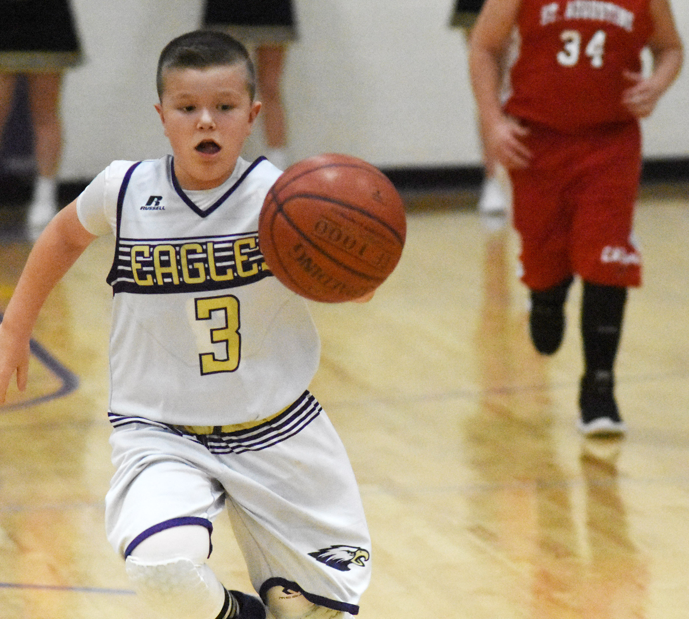 Campbellsville Elementary School fourth-grader Cayton Lawhorn dribbles.