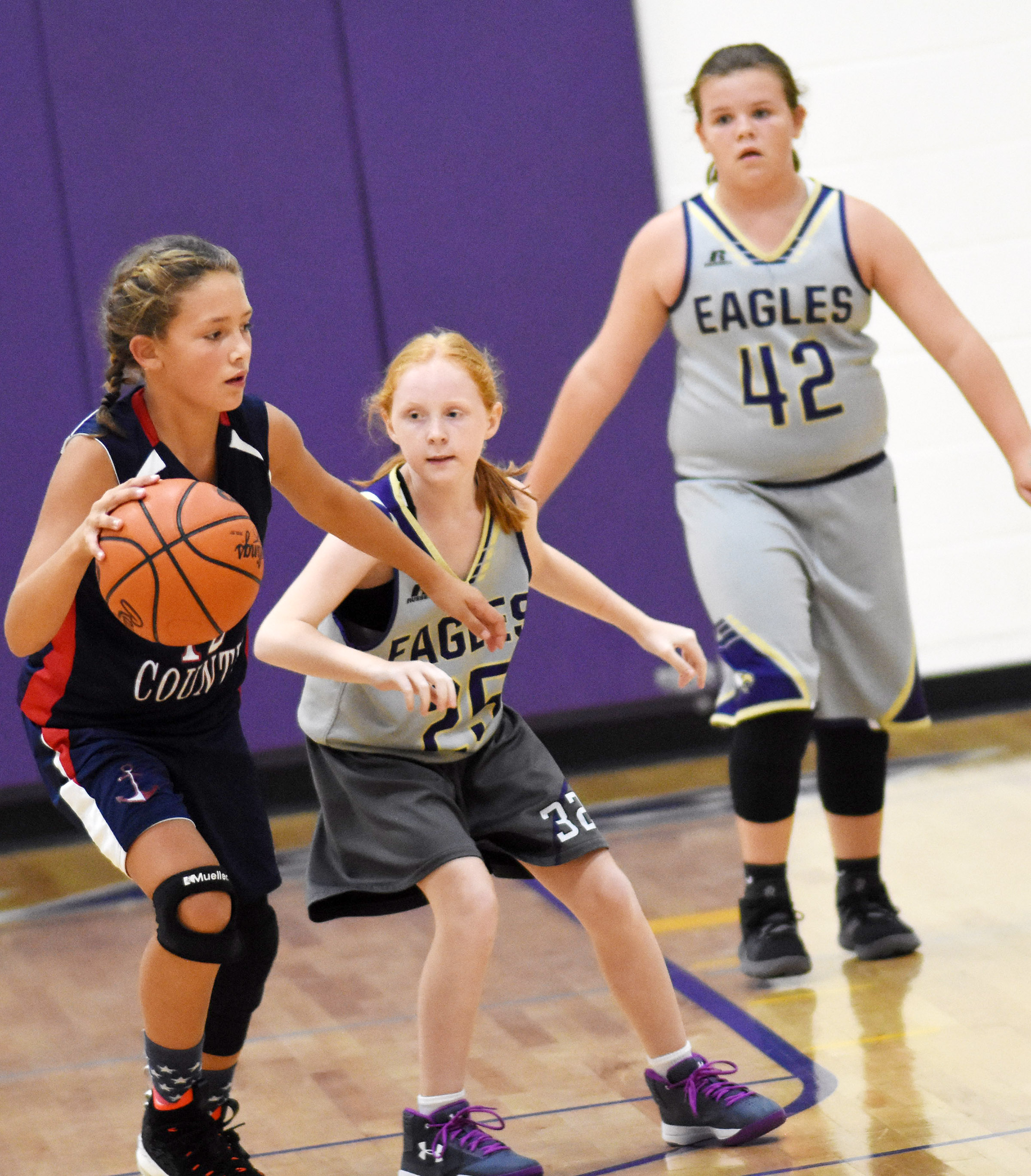 Campbellsville Elementary School fifth-grader Nora Harris fights for the ball.