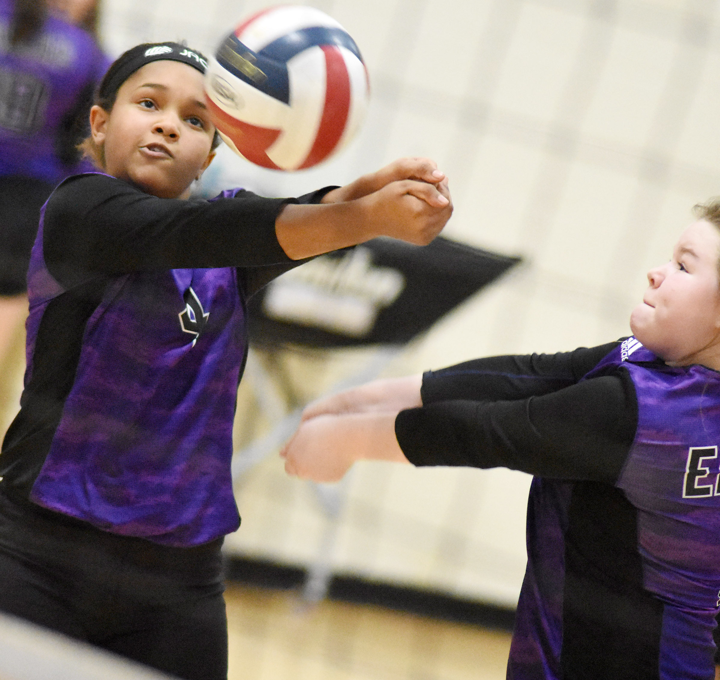 CMS sixth-graders Jaclyn Jackson, at left, and Miley Hash go for the ball.