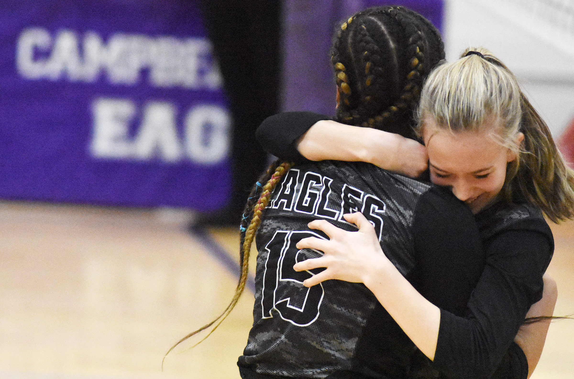 CMS eighth-grader Antaya Epps and seventh-grader Chloe Thompson hug after their win.