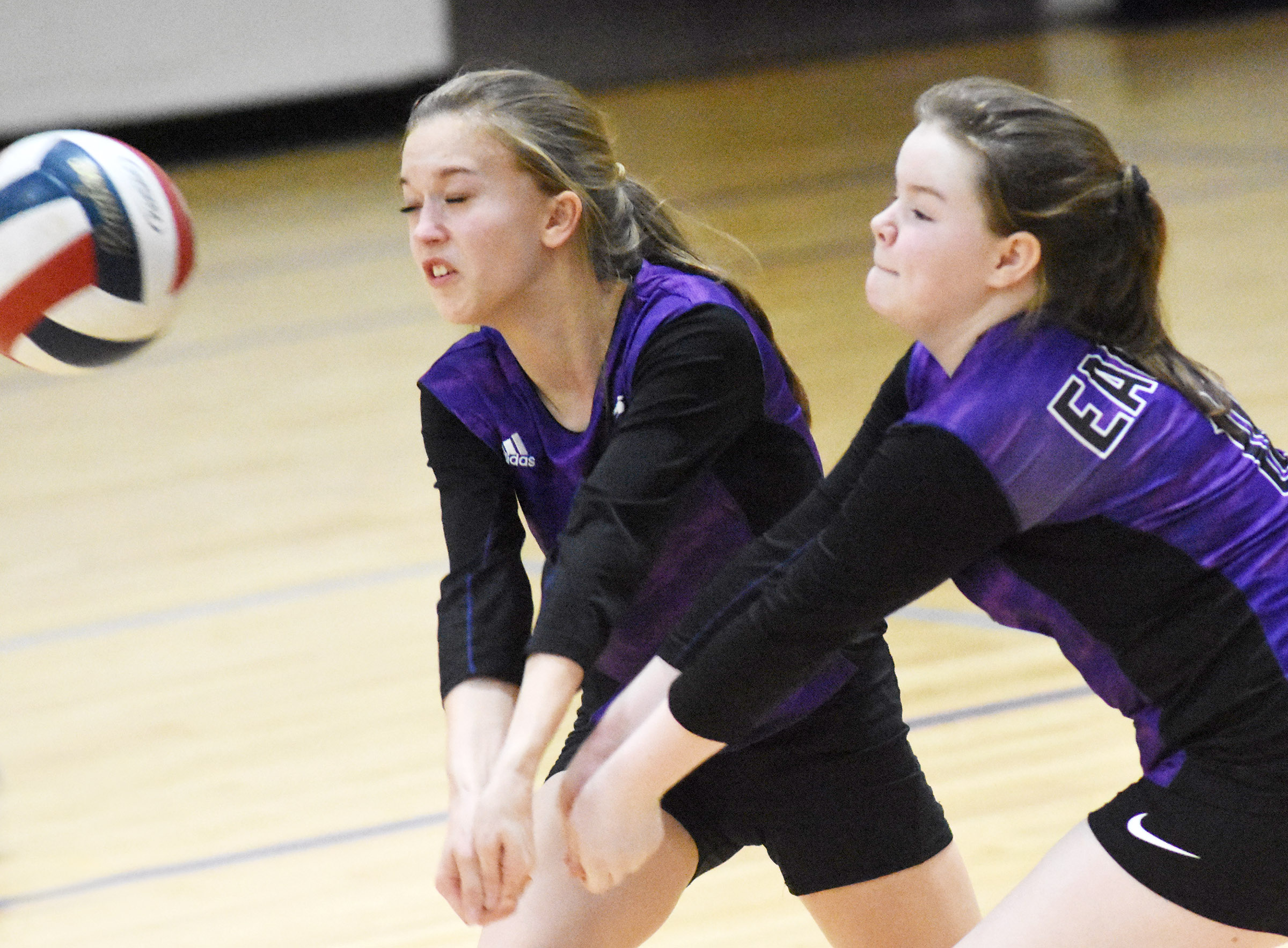 CMS seventh-grader Chloe Thompson, at left, and sixth-grader Miley Hash go for the ball.