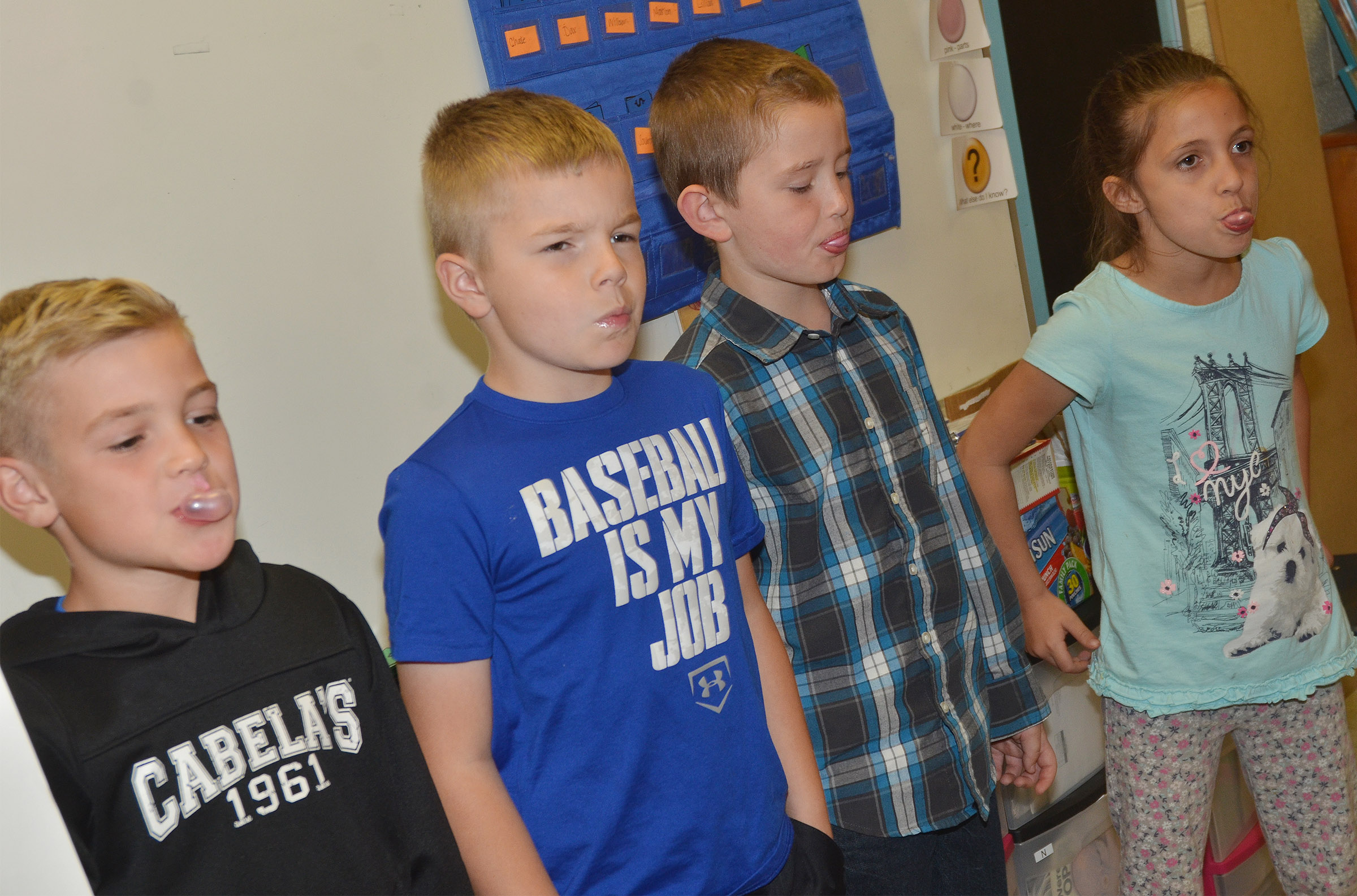 From left, CES first-graders Dax Gray, Brady Cox, Kevin Bradfield and Lillian Martin blow bubbles.