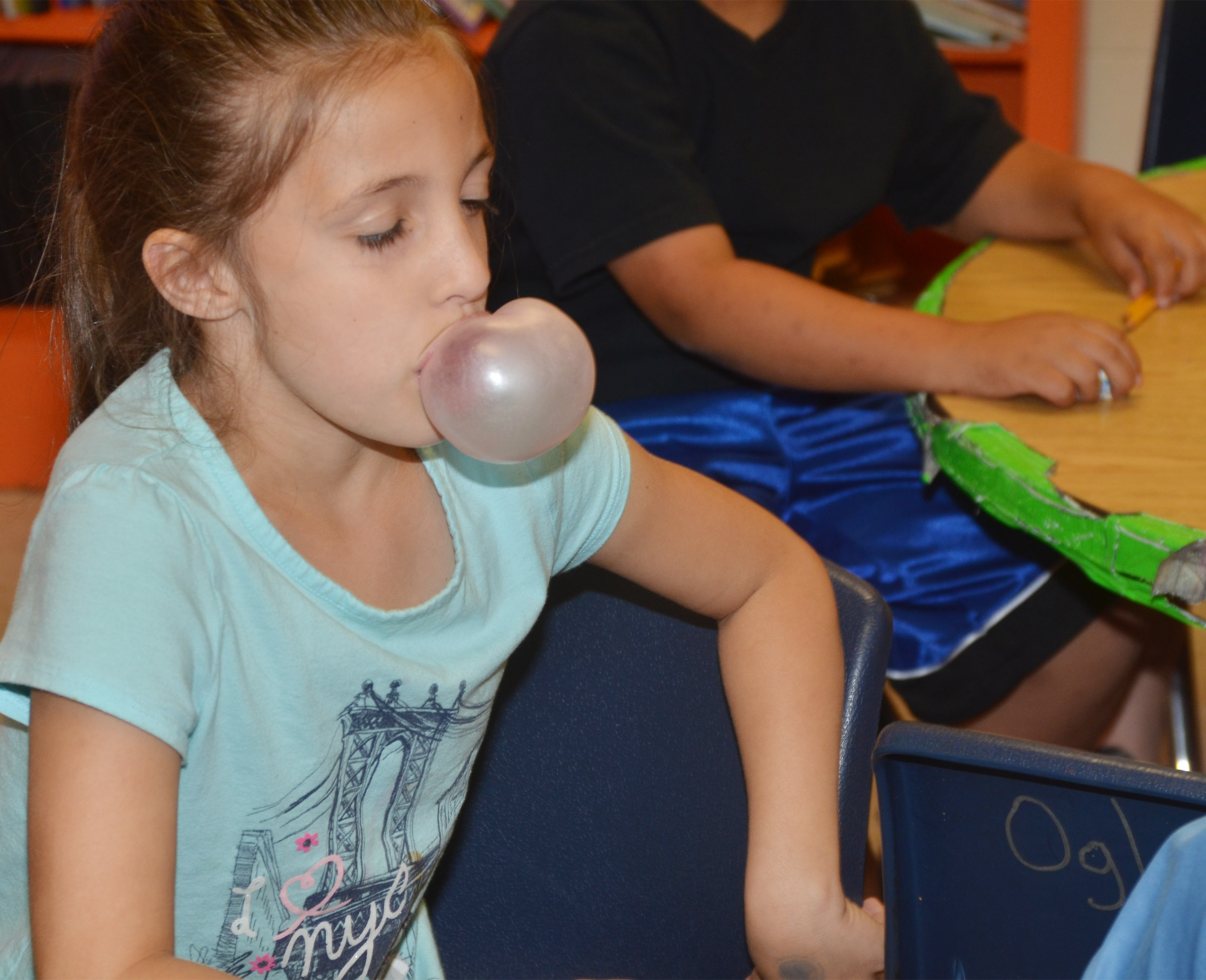 CES first-grader Lillian Martin blows a bubble.