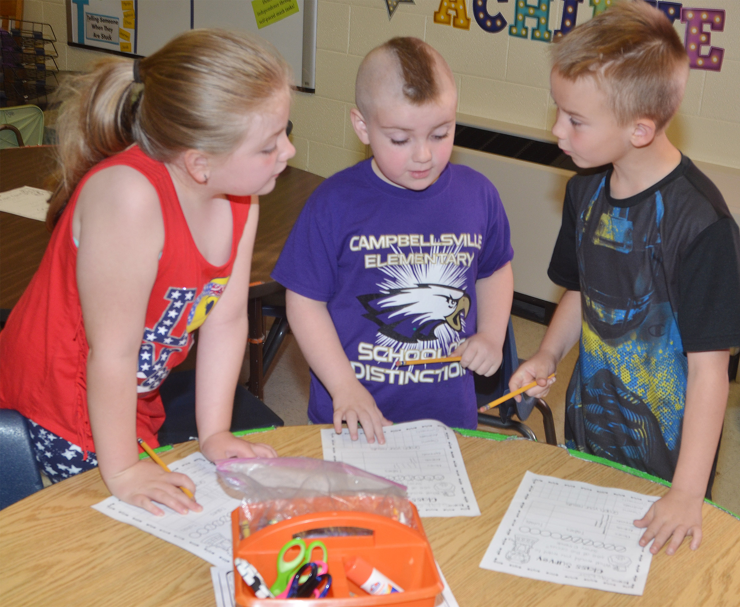 CES first-graders, from left, London Whitlow, Drake Edwards and Jackson Bates survey each other.