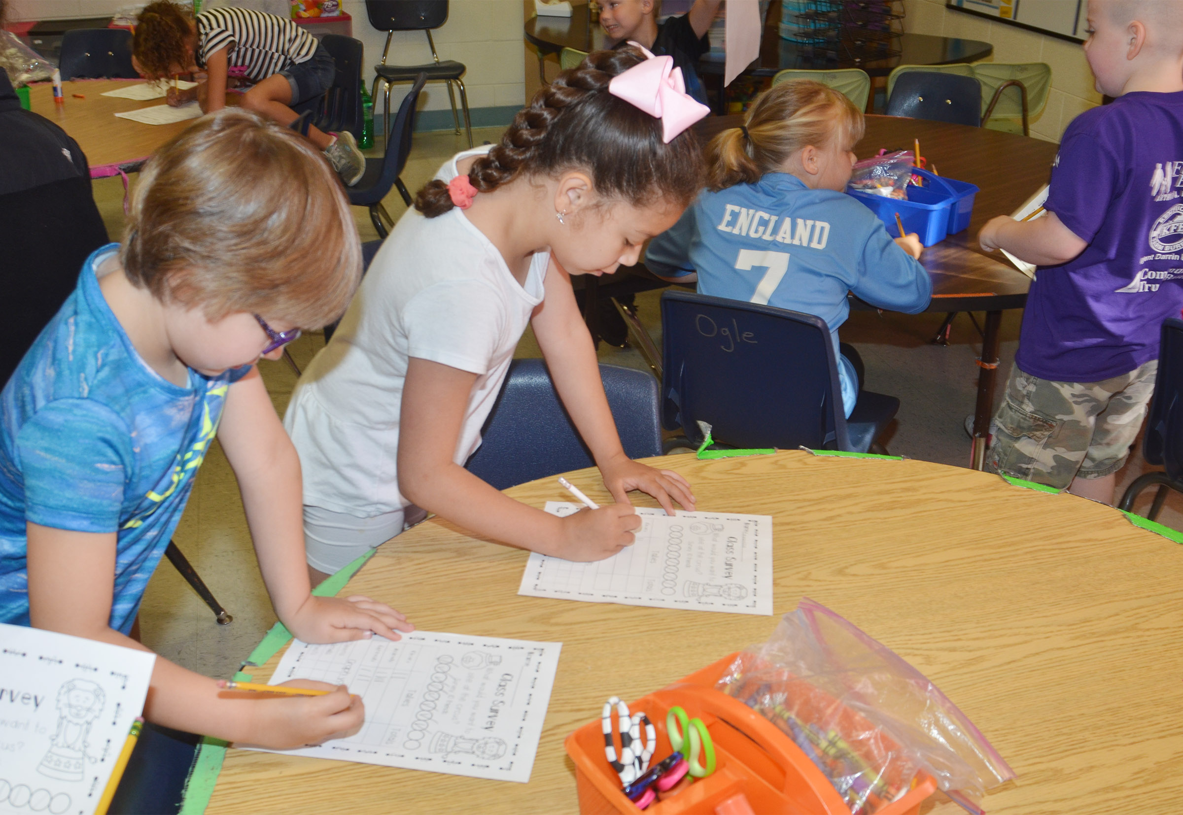 CES first-graders Addelyn Dooley, at left, and Lillian Martin survey each other.