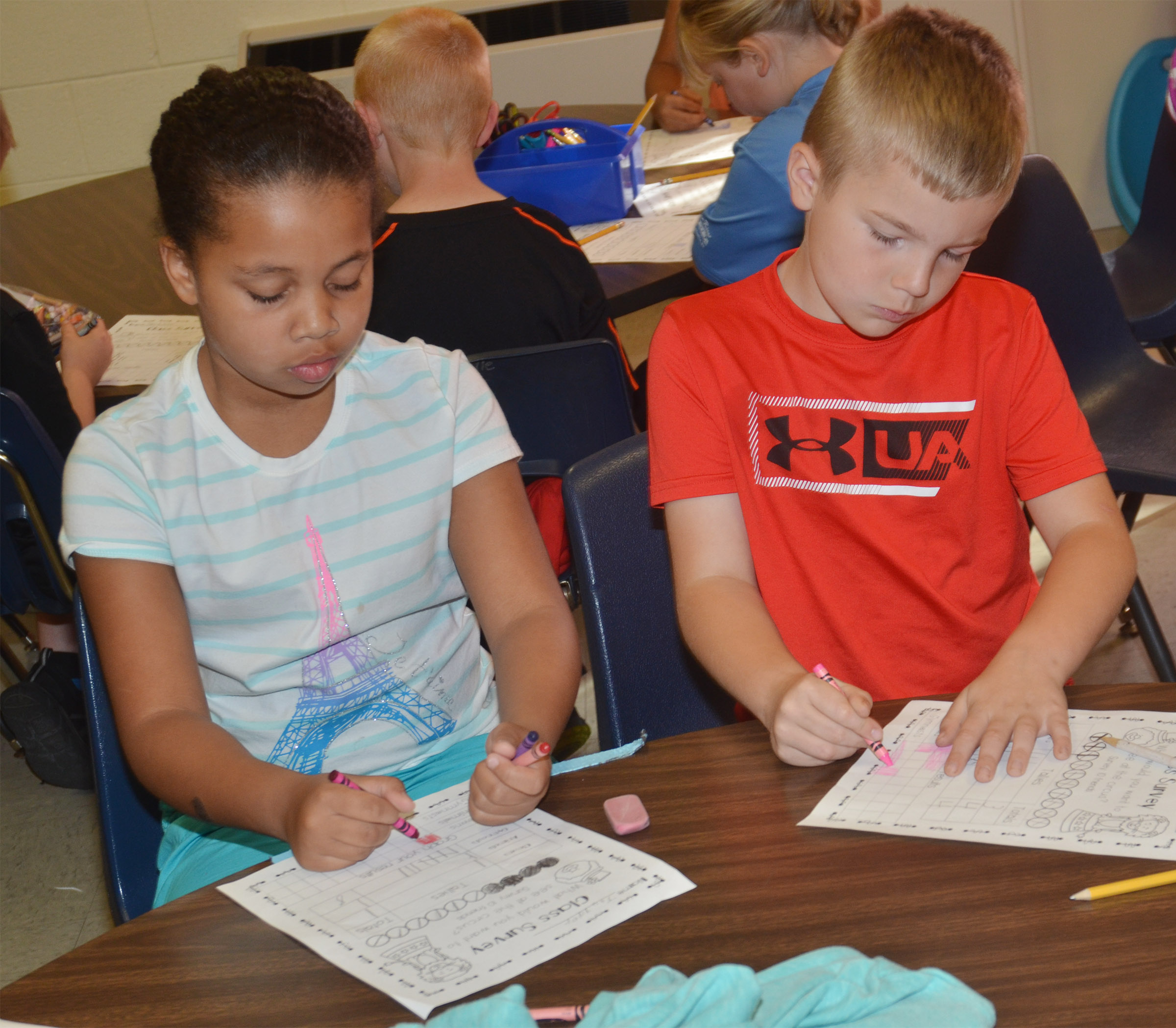 CES first-graders Journey Webb, at left, and Brady Cox survey each other.