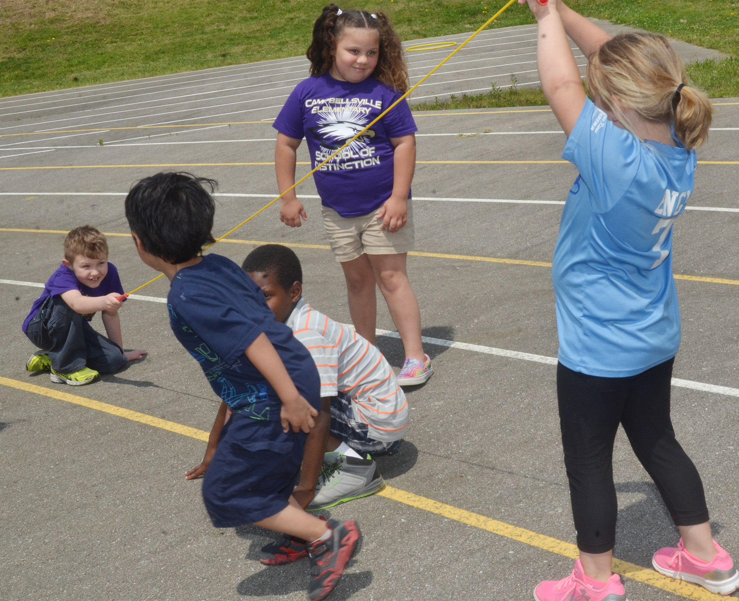 CES first-graders play jump rope together.