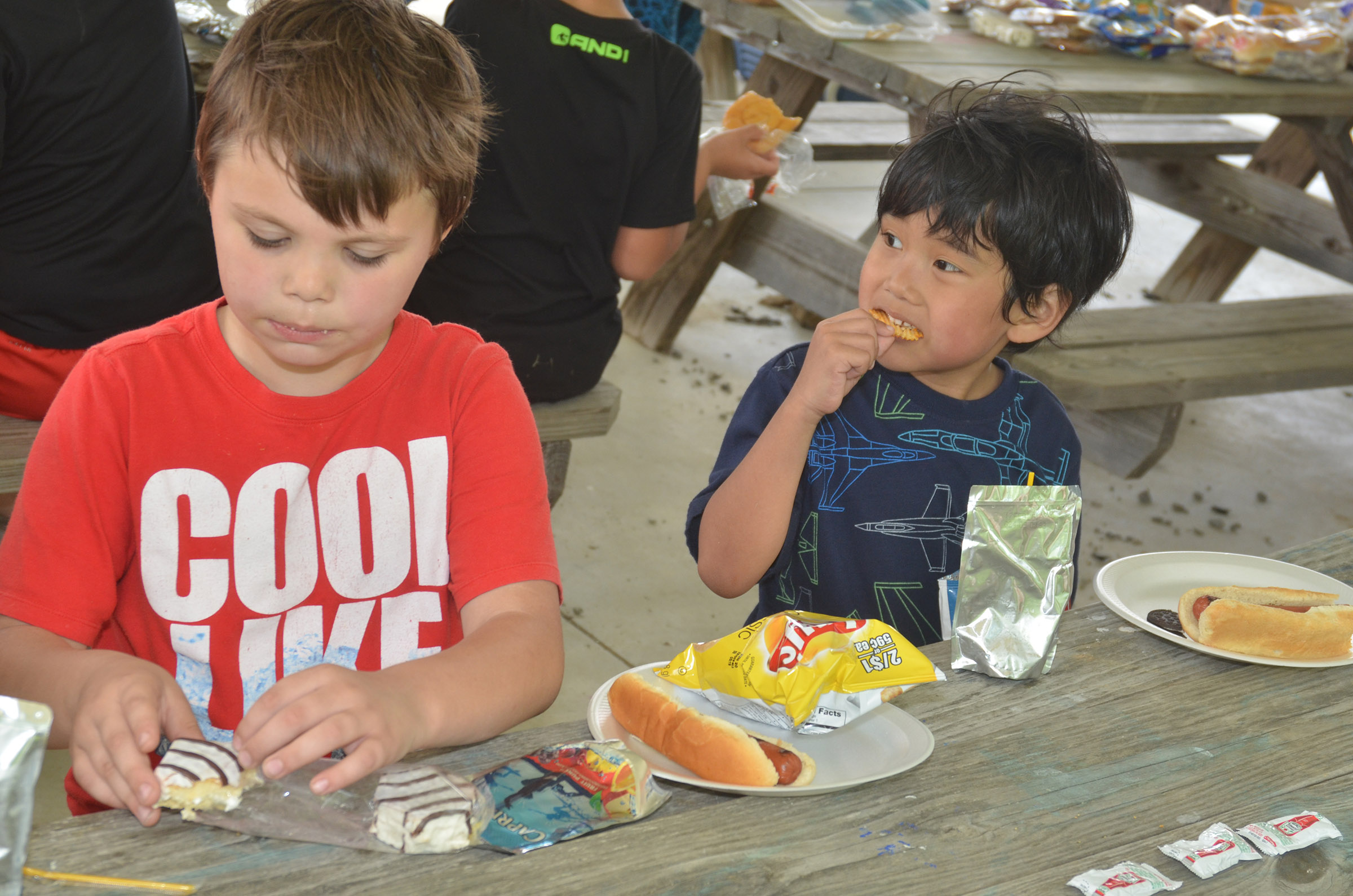 CES first-graders Jaxson Hunt, at left, and Zach Hak enjoy their cookout.
