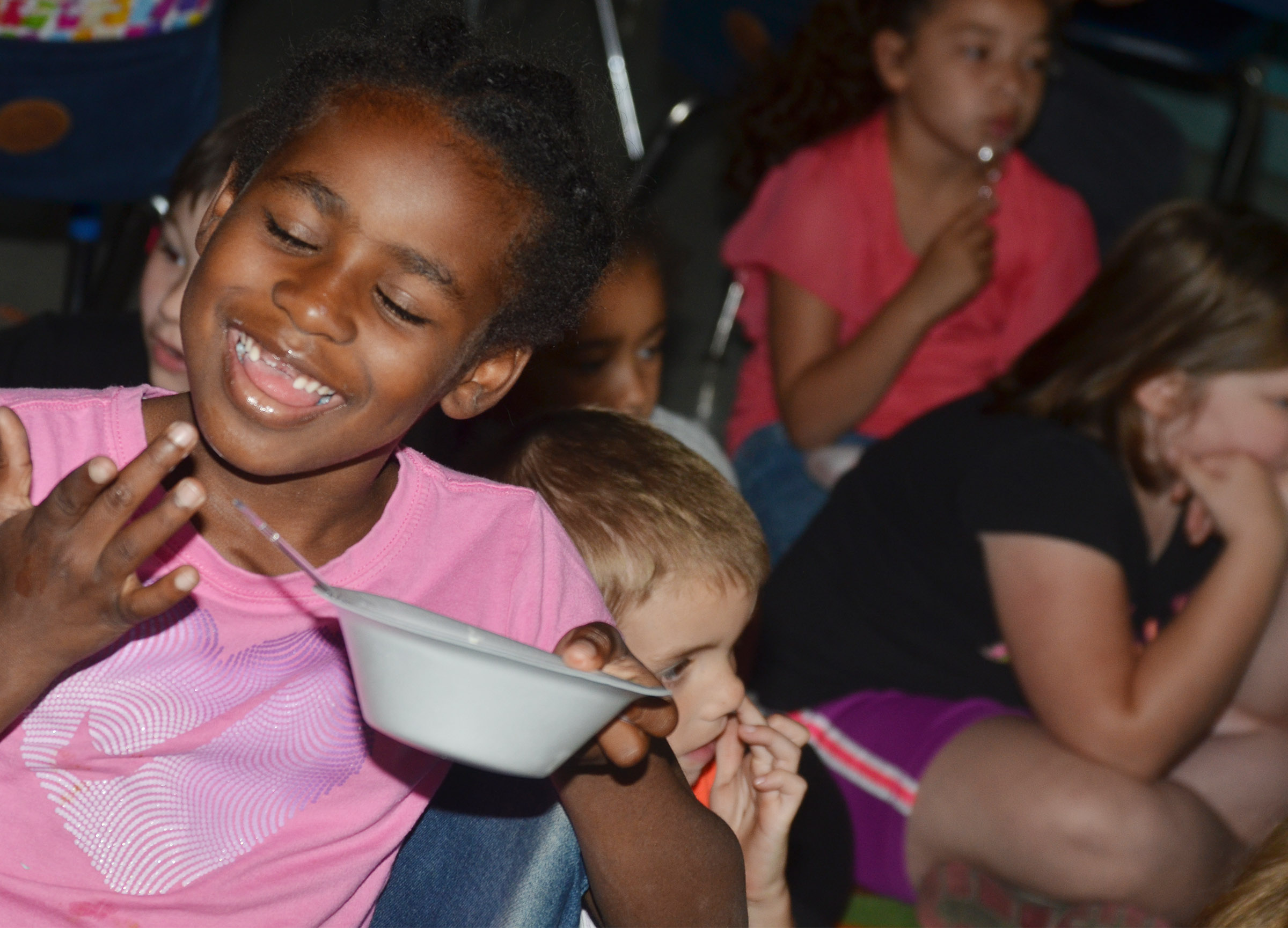CES first-grader Destini Gholston enjoys her ice cream sundae.