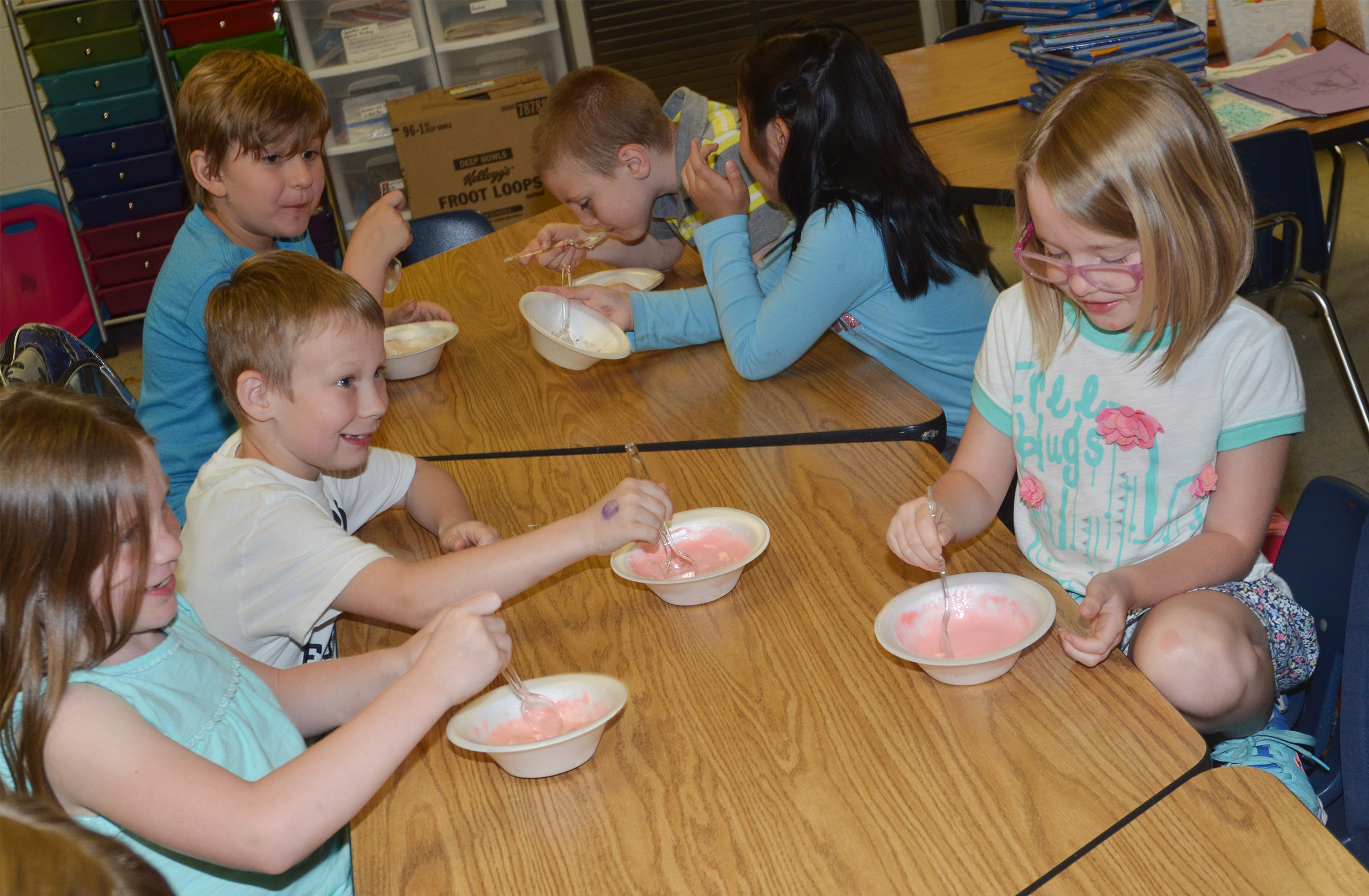 CES first-grade students enjoy their ice cream sundaes.