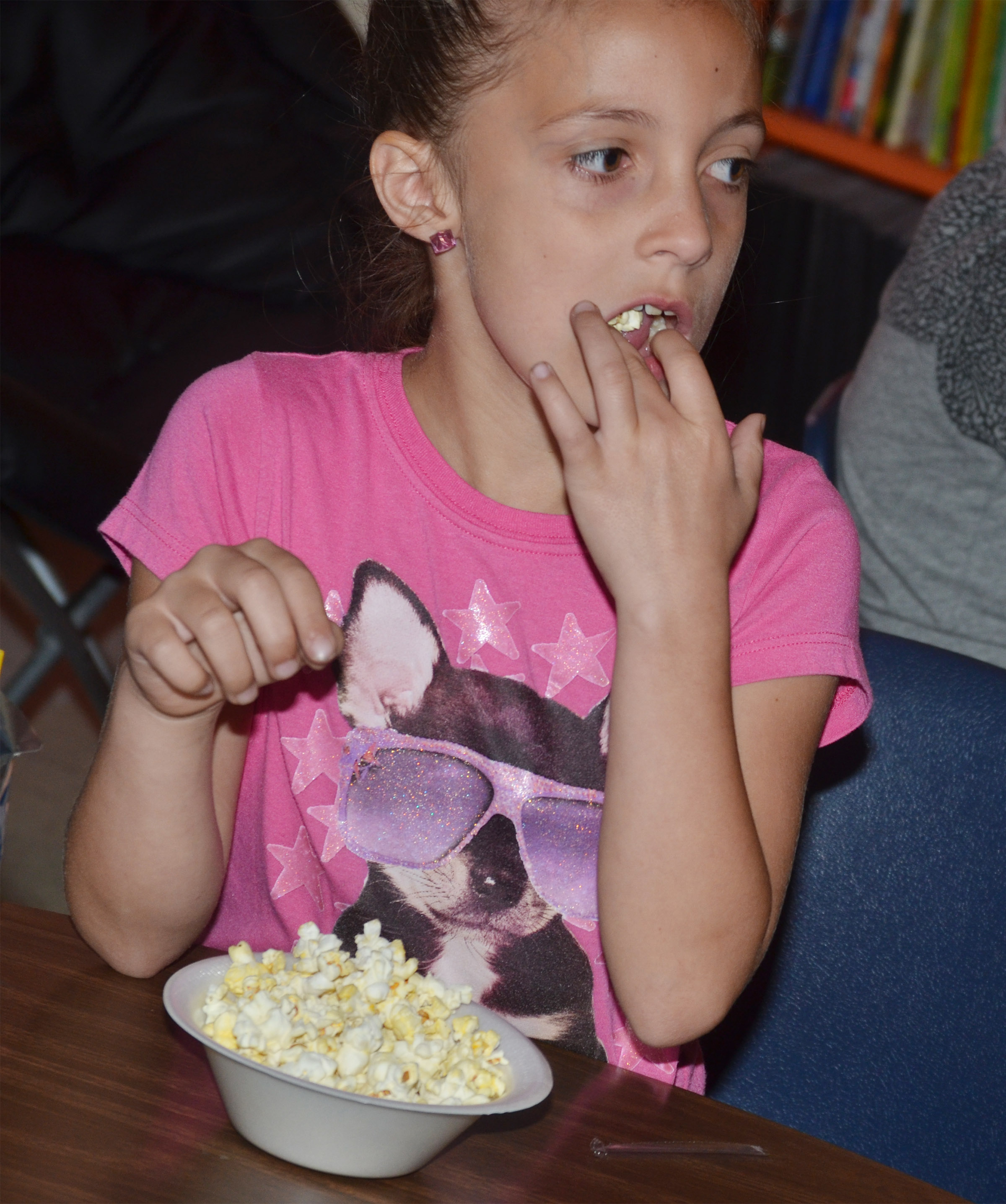 CES first-grader Lillian Martin enjoys her popcorn snack.