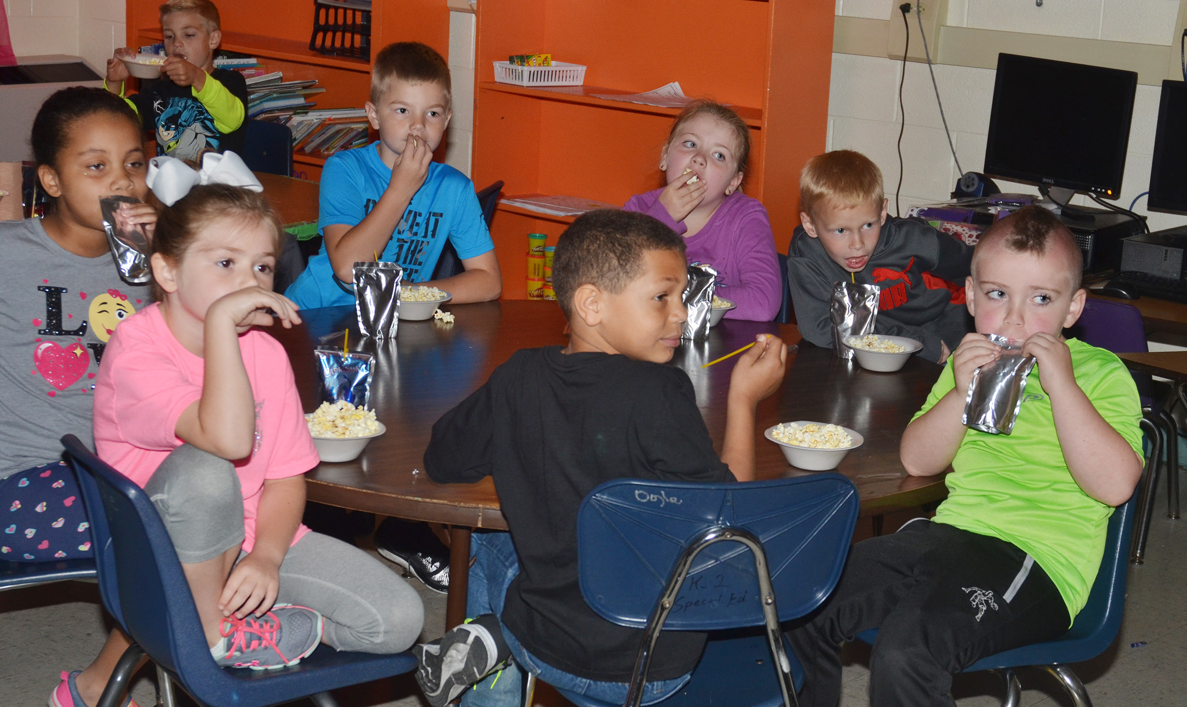 CES first-graders in Hailey Gregory's class enjoy their popcorn snack.