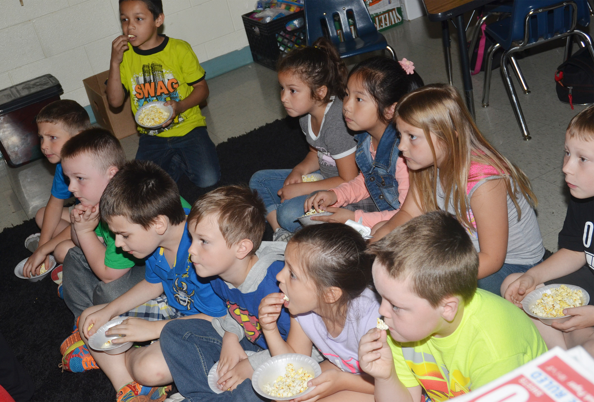 CES first-graders in Amanda Greer's class enjoy their popcorn snack.