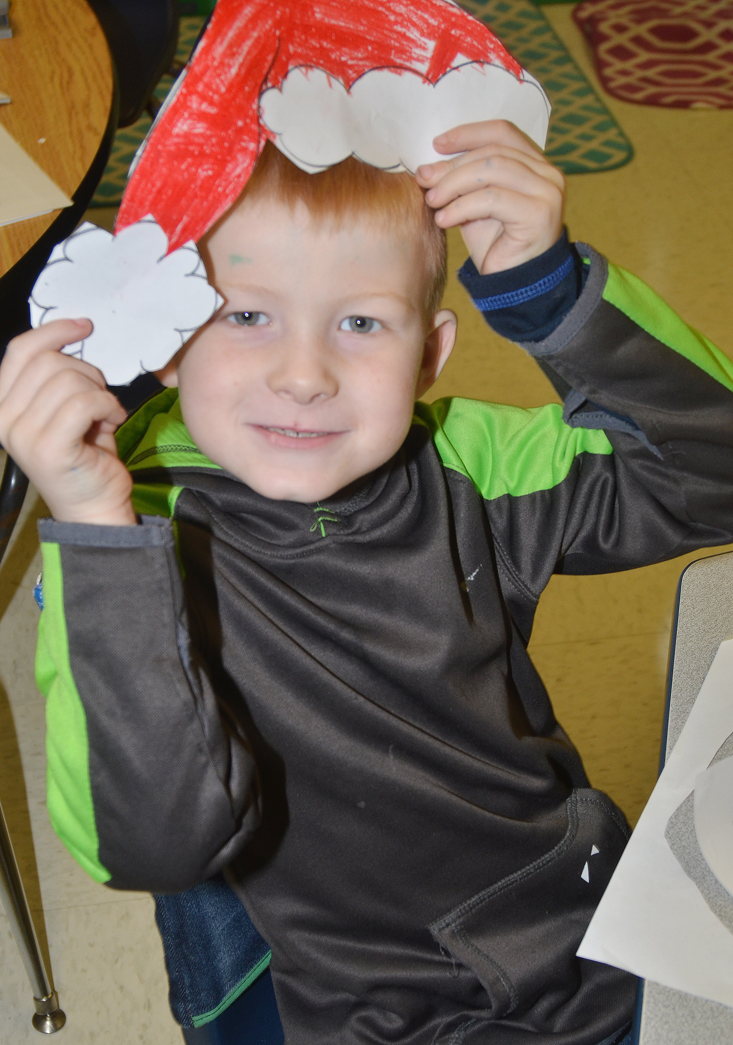 CES first-grader Jayden Maupin poses as Santa Claus.