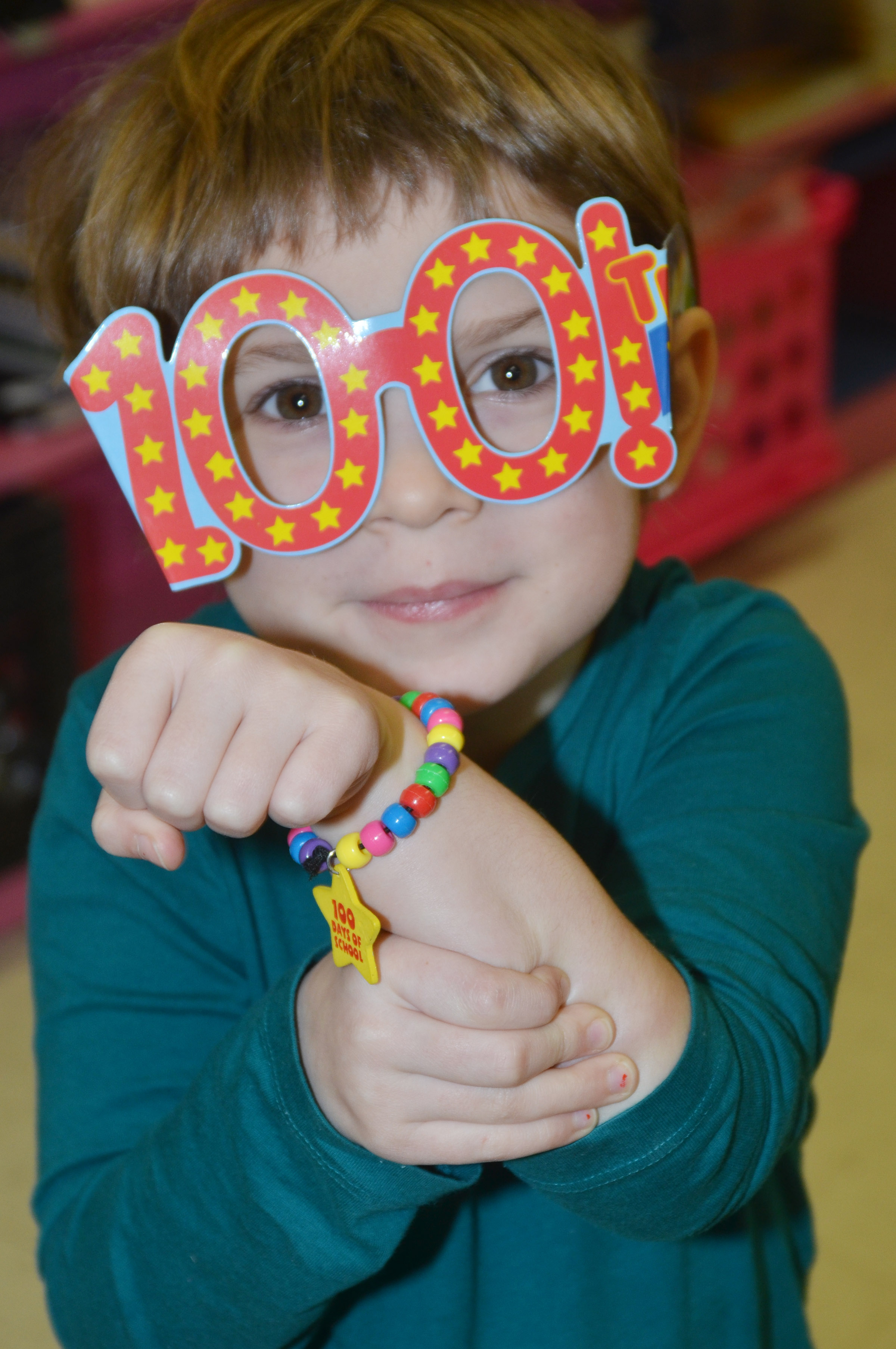 CES kindergartener Evelyn Reed celebrates the 100th day of school with special glasses and a bracelet.