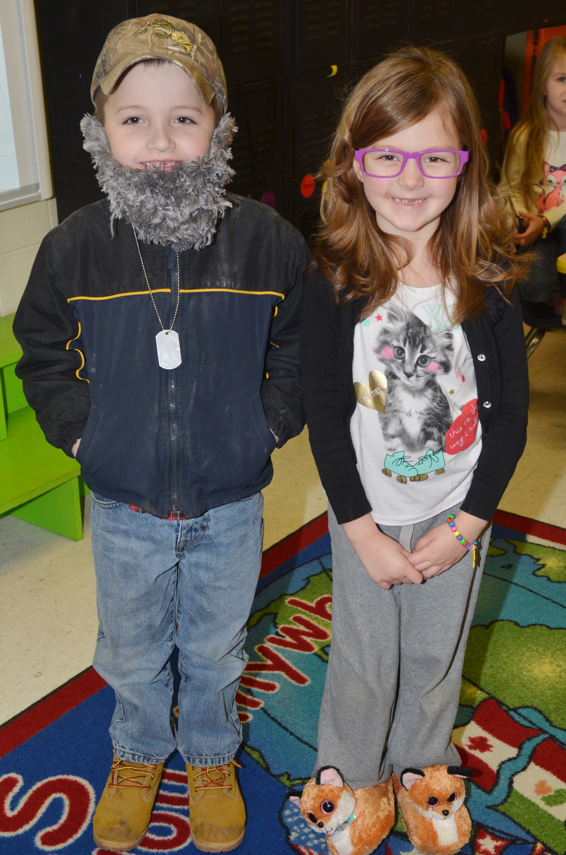 CES kindergarteners Timothy Stacy, at left, and Delaney Staton dress as if they were 100 years old.