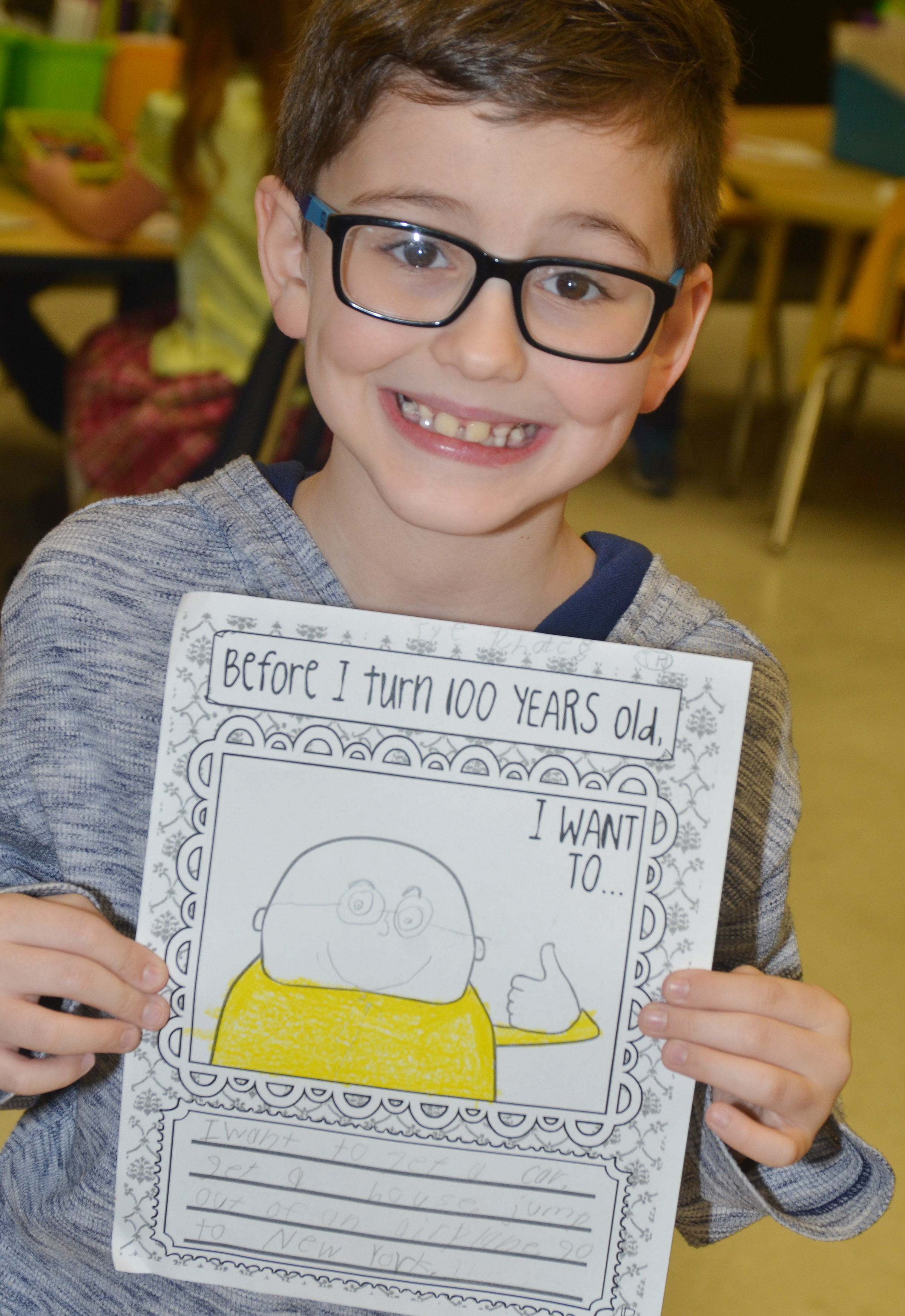 CES second-grader Tye Rhodes writes about what he hopes to do before turning 100. He hopes to buy a car and a house, jump out of an airplane and travel to New York.