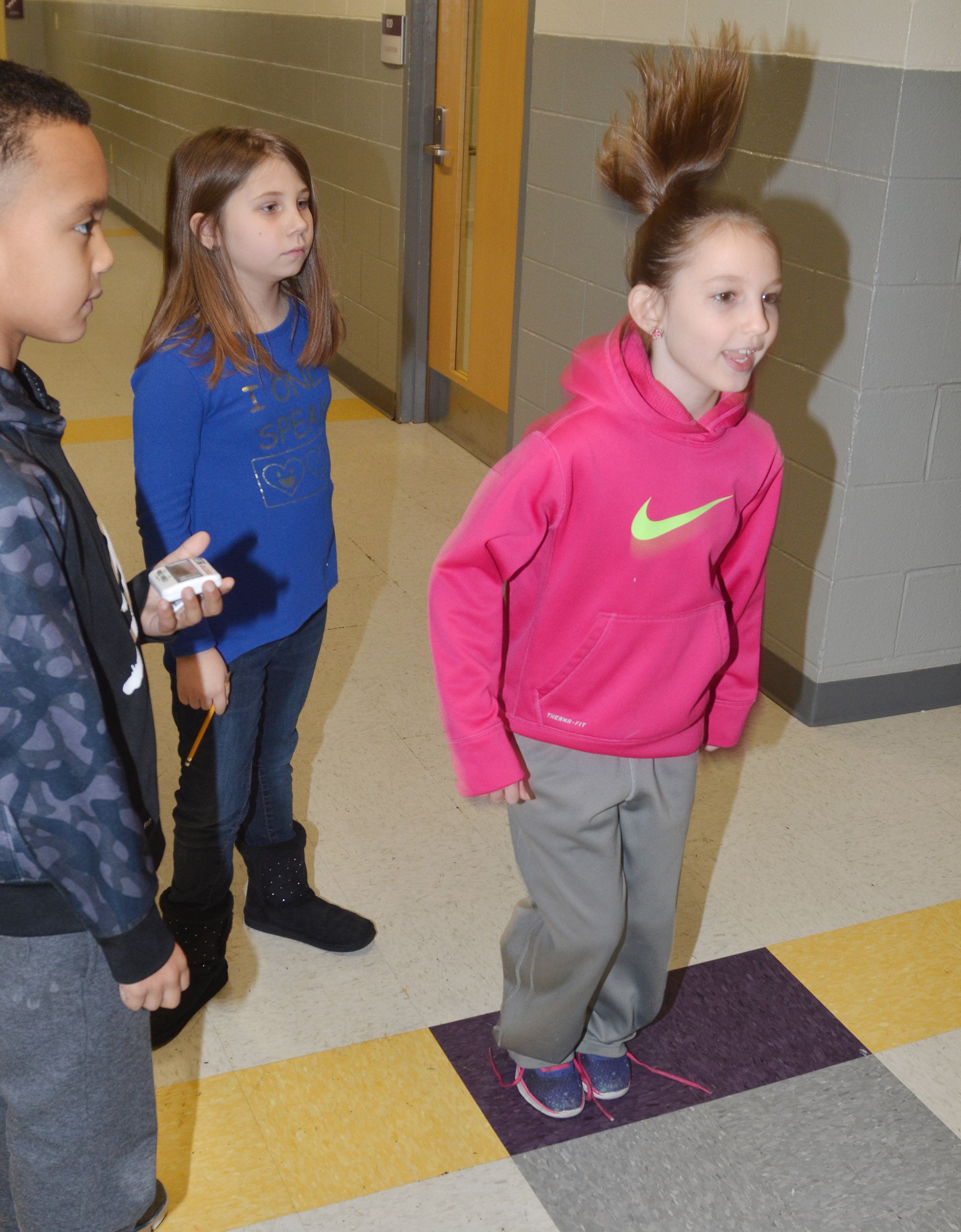 CES second-graders Kairi Tucker jumps for 100 seconds, as classmate Maddox Hawkins times her.