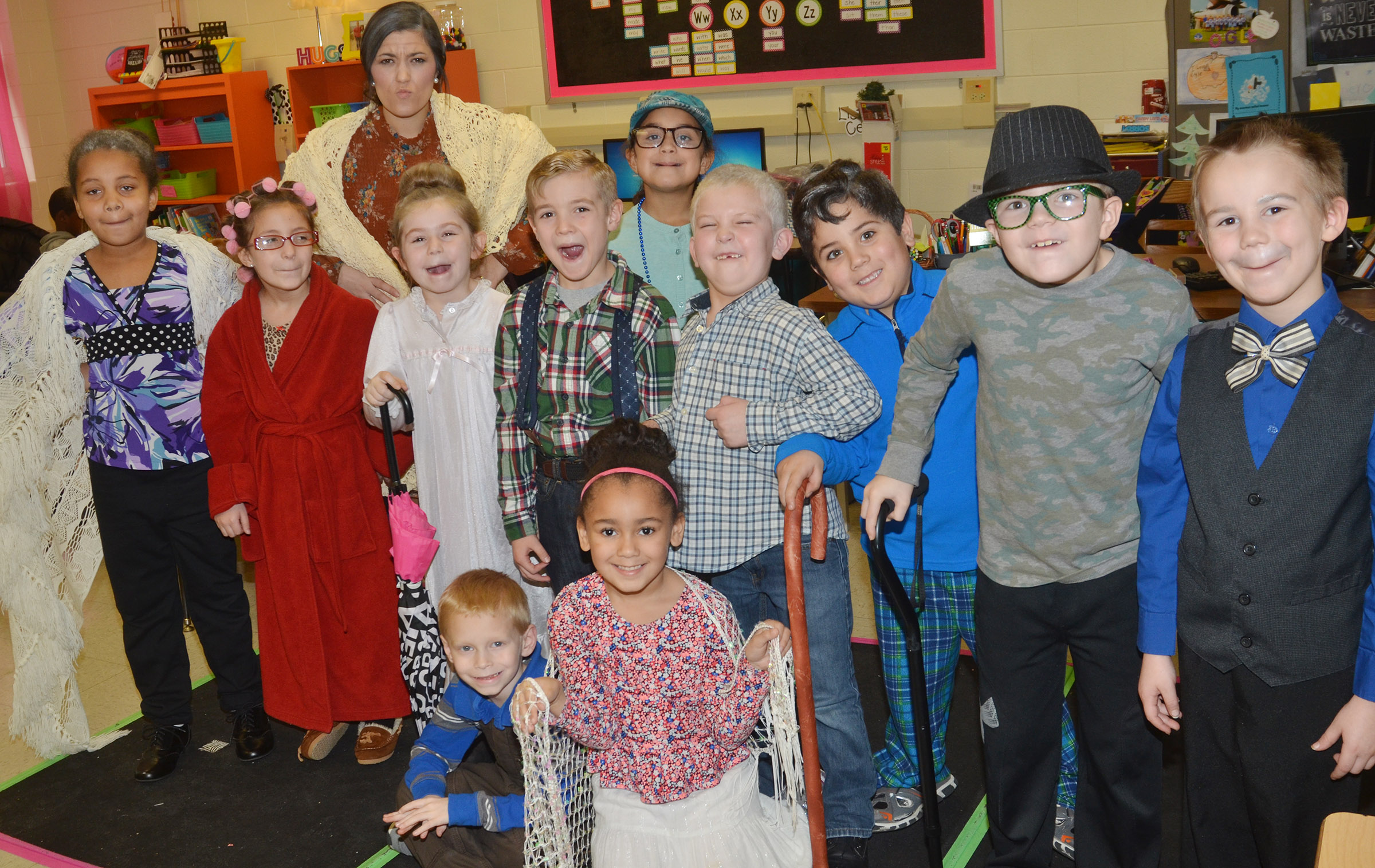 CES first-grade teacher Hailey Ogle and her students dress as if they are 100 years old.