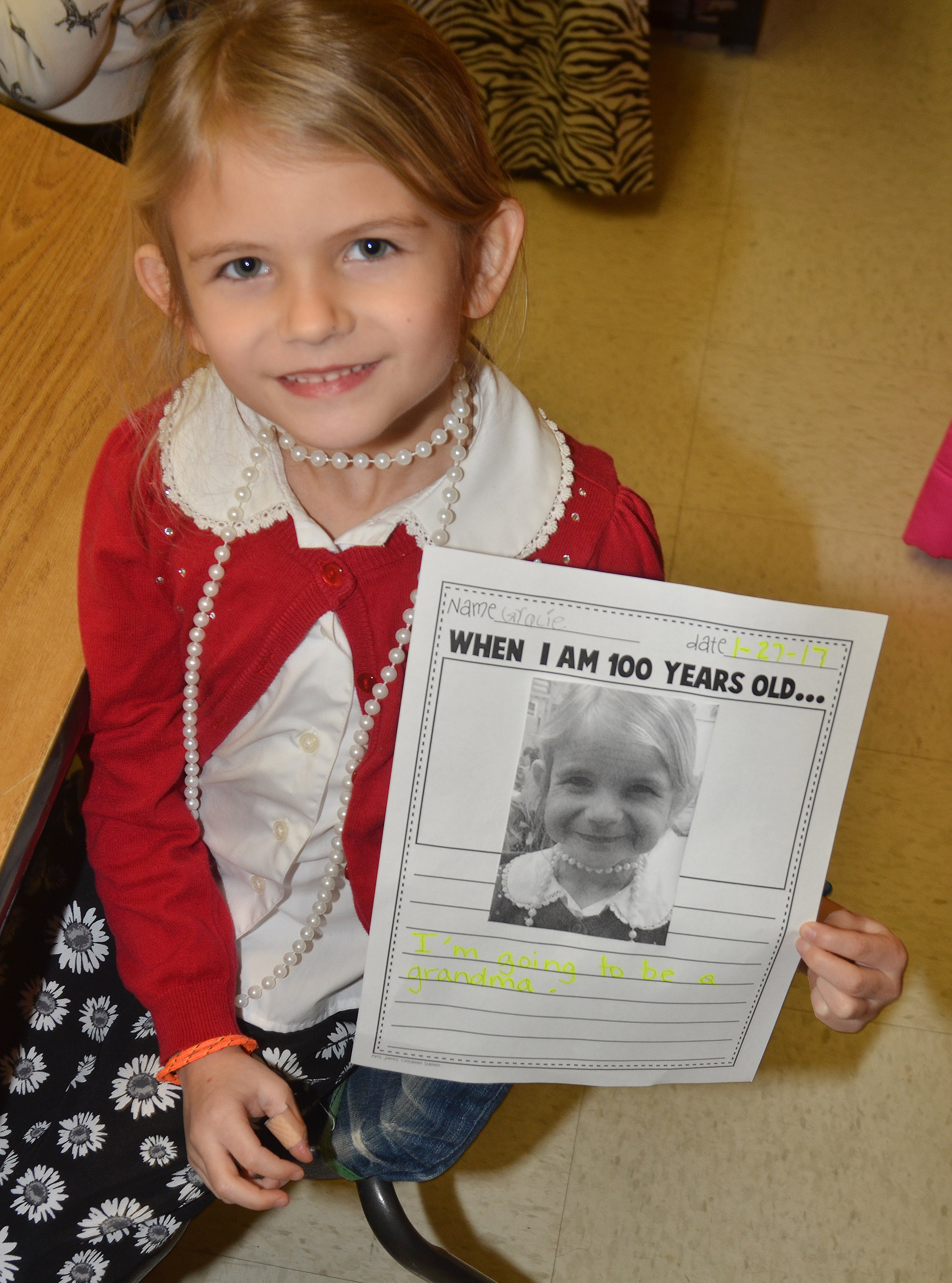 CES kindergartener Gracie Gebler holds a photo of what she will look like when she is 100 years old.