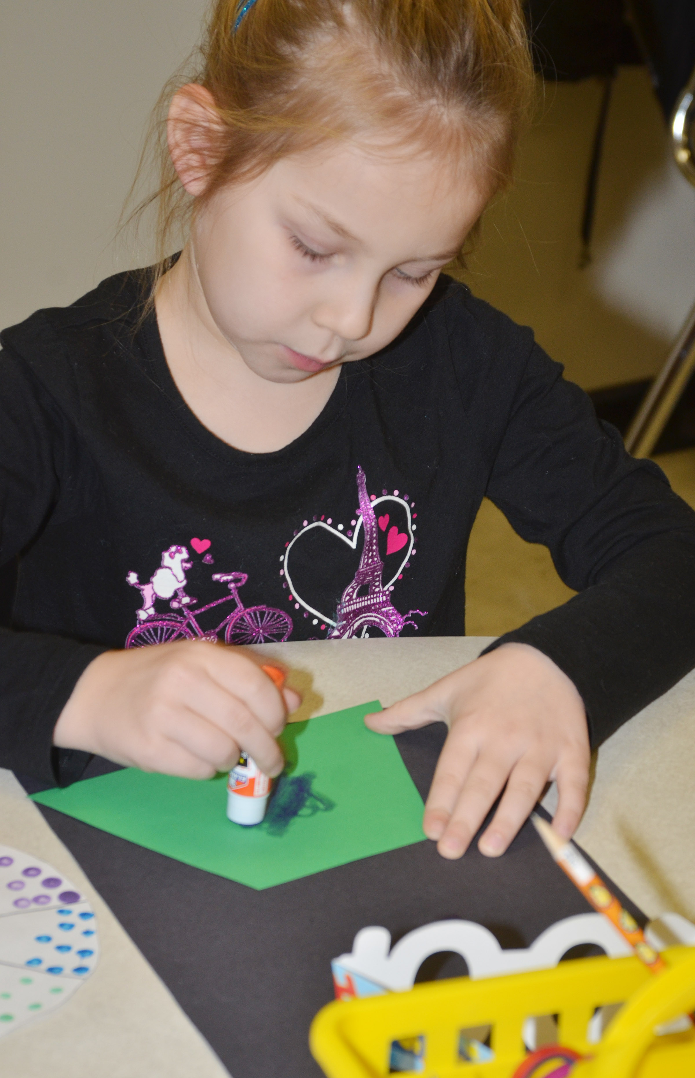 CES kindergartener Kira Dotson makes a gumball machine filled with 100 dots.