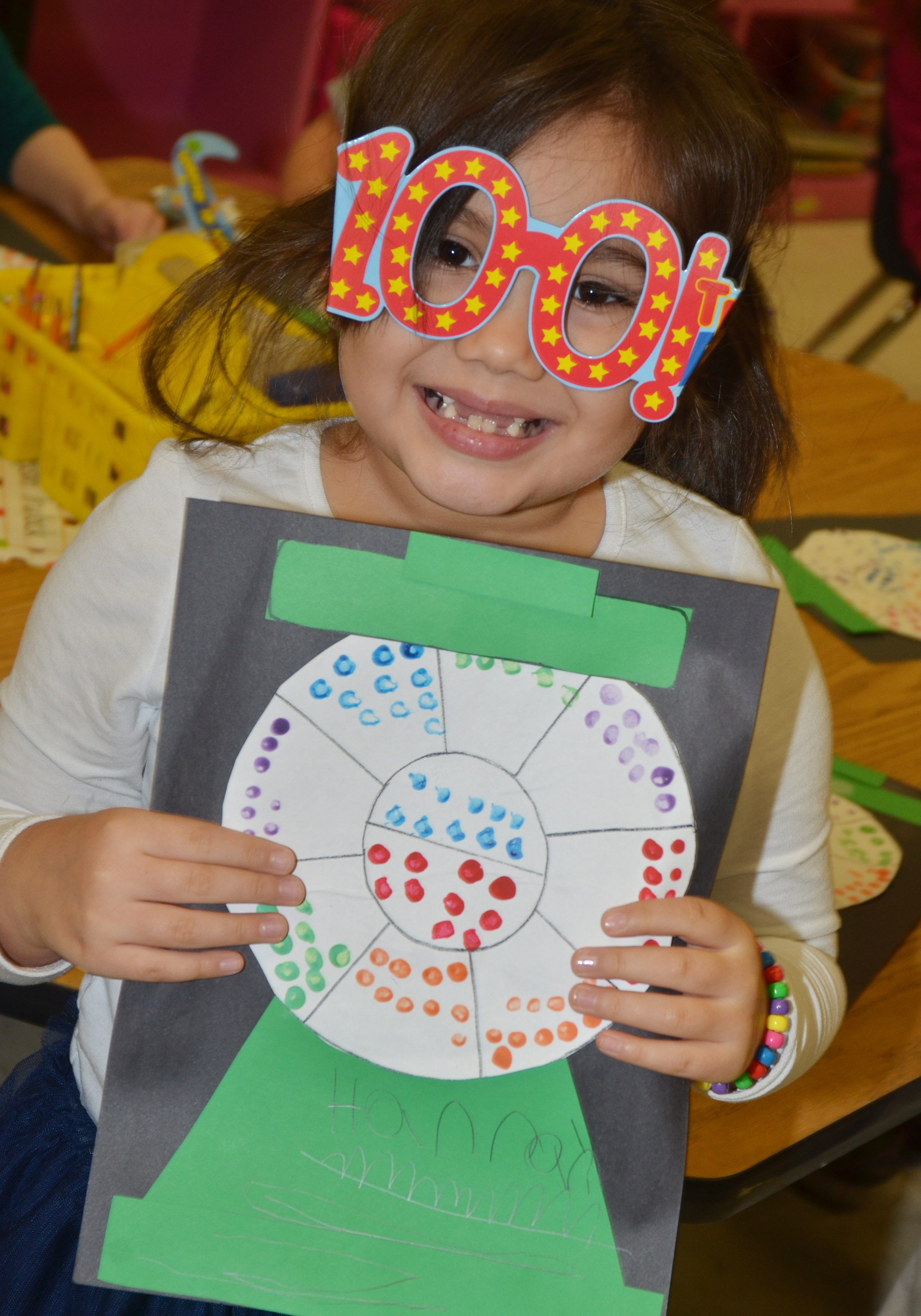 CES kindergartener Hannah Matias holds her gumball machine, which is filled with 100 dots.