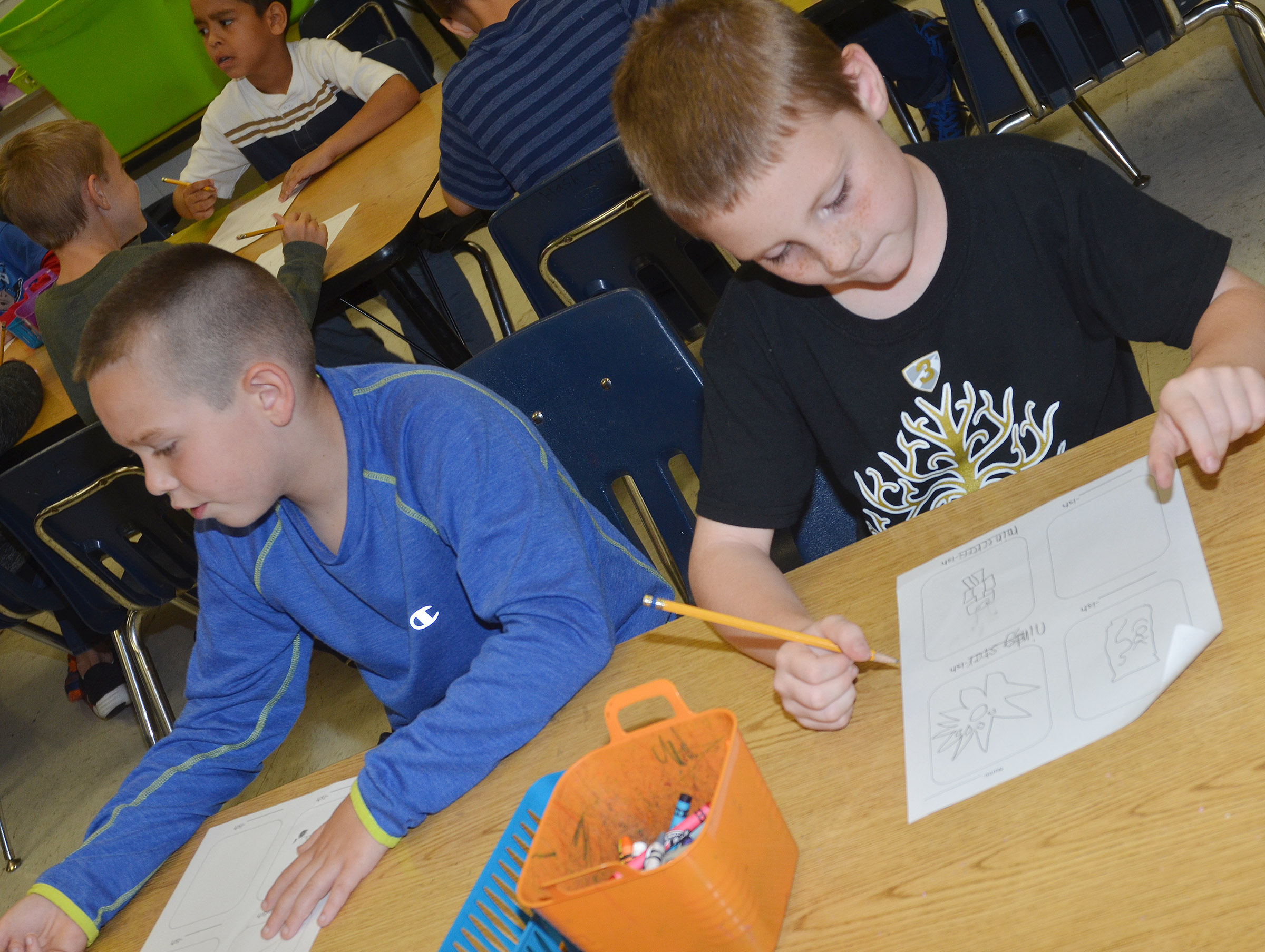 "CES second-graders Colton Maggard, at left, and James Brunner create their ""-ish"" drawings."