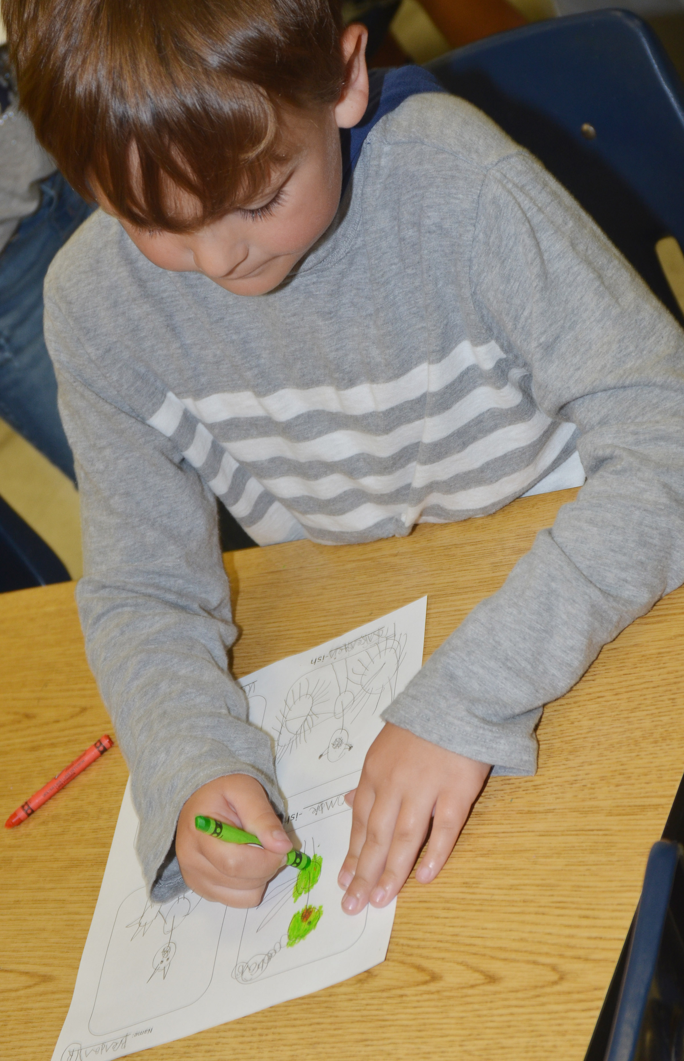 "CES second-grader Brendan Martin colors his ""-ish"" drawings."