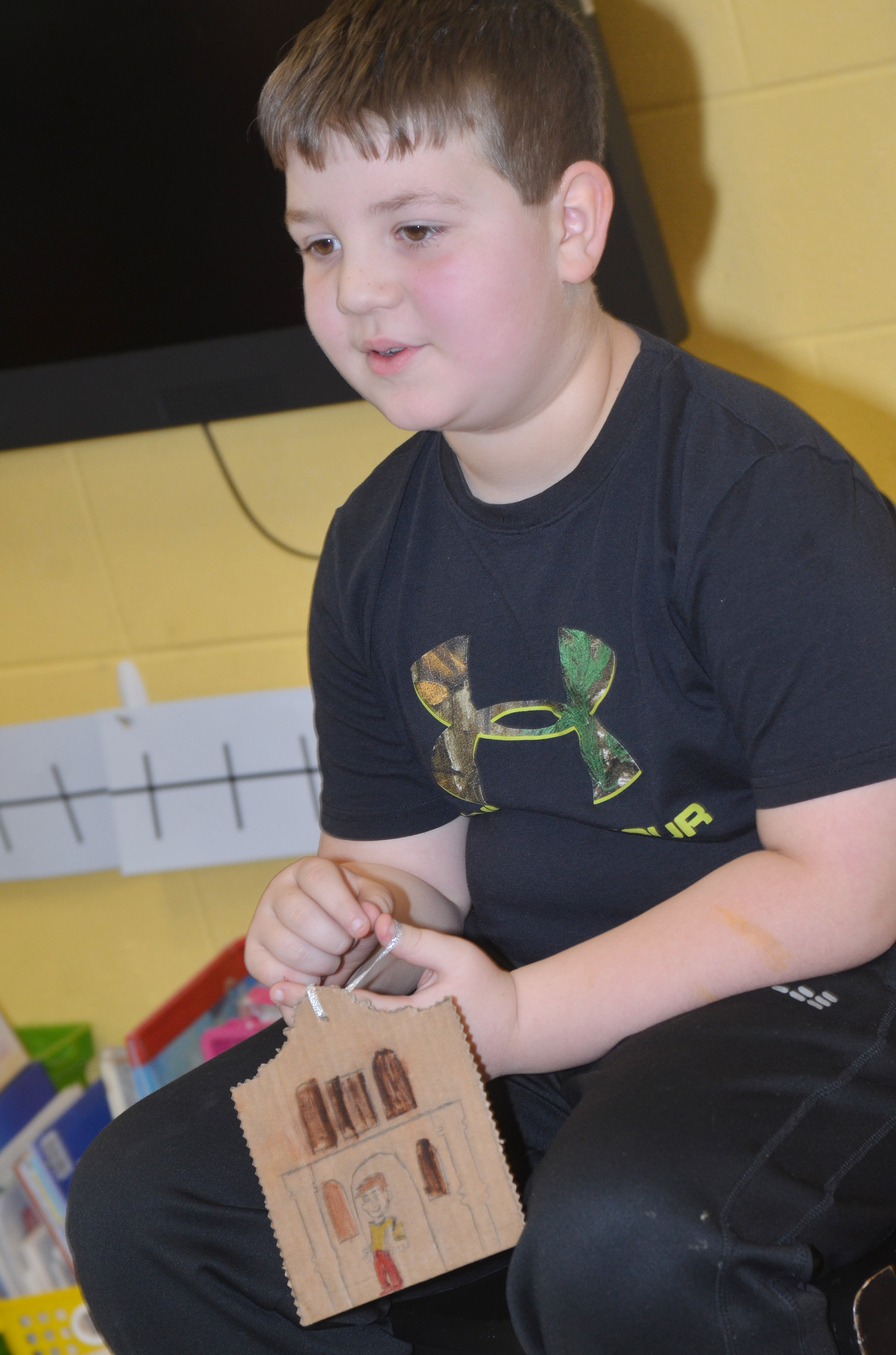 CES second-grader Luke Mardis tells his classmates about his ornament.
