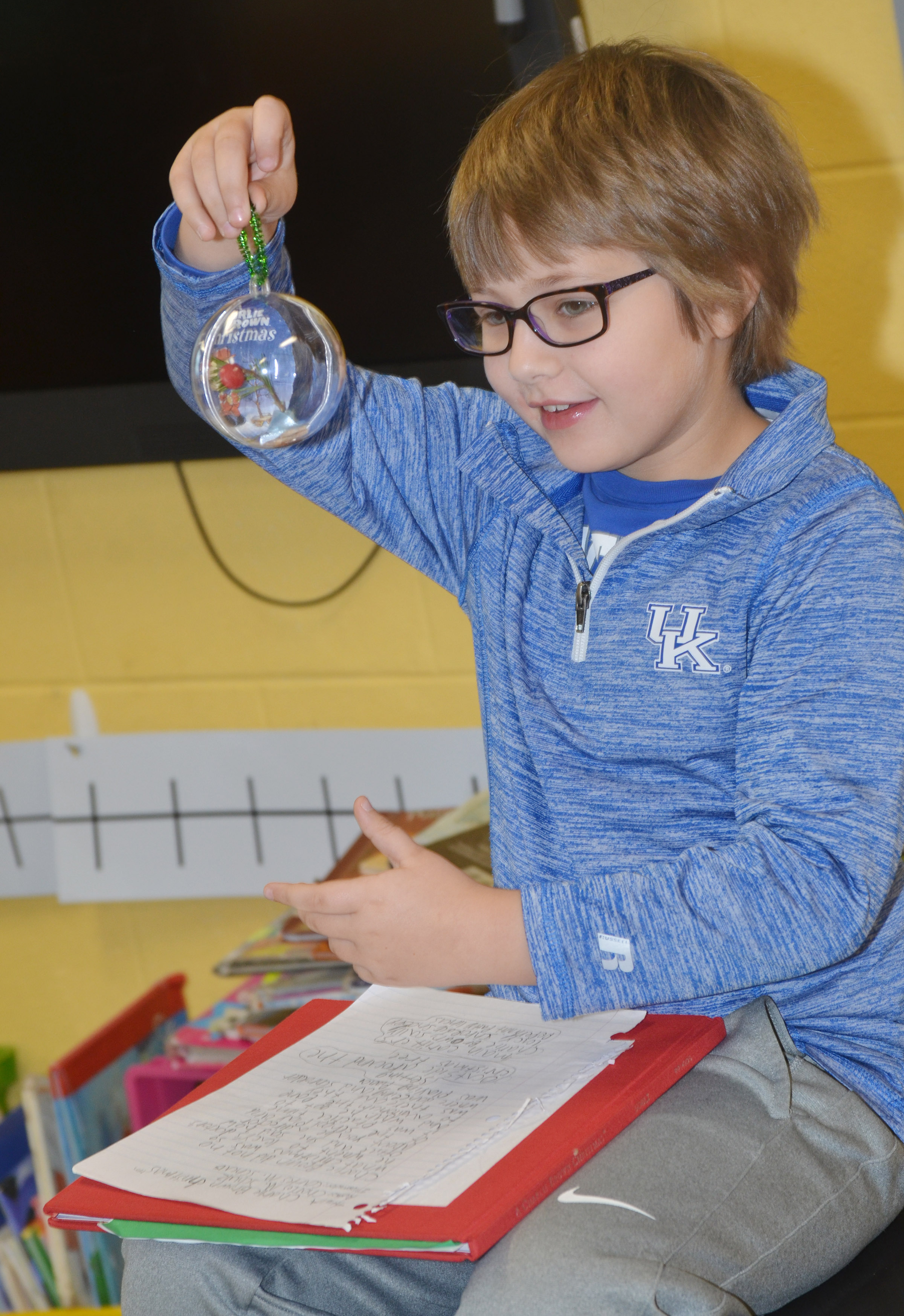 CES second-grader Addelyn Dooley tells her classmates about her ornament.