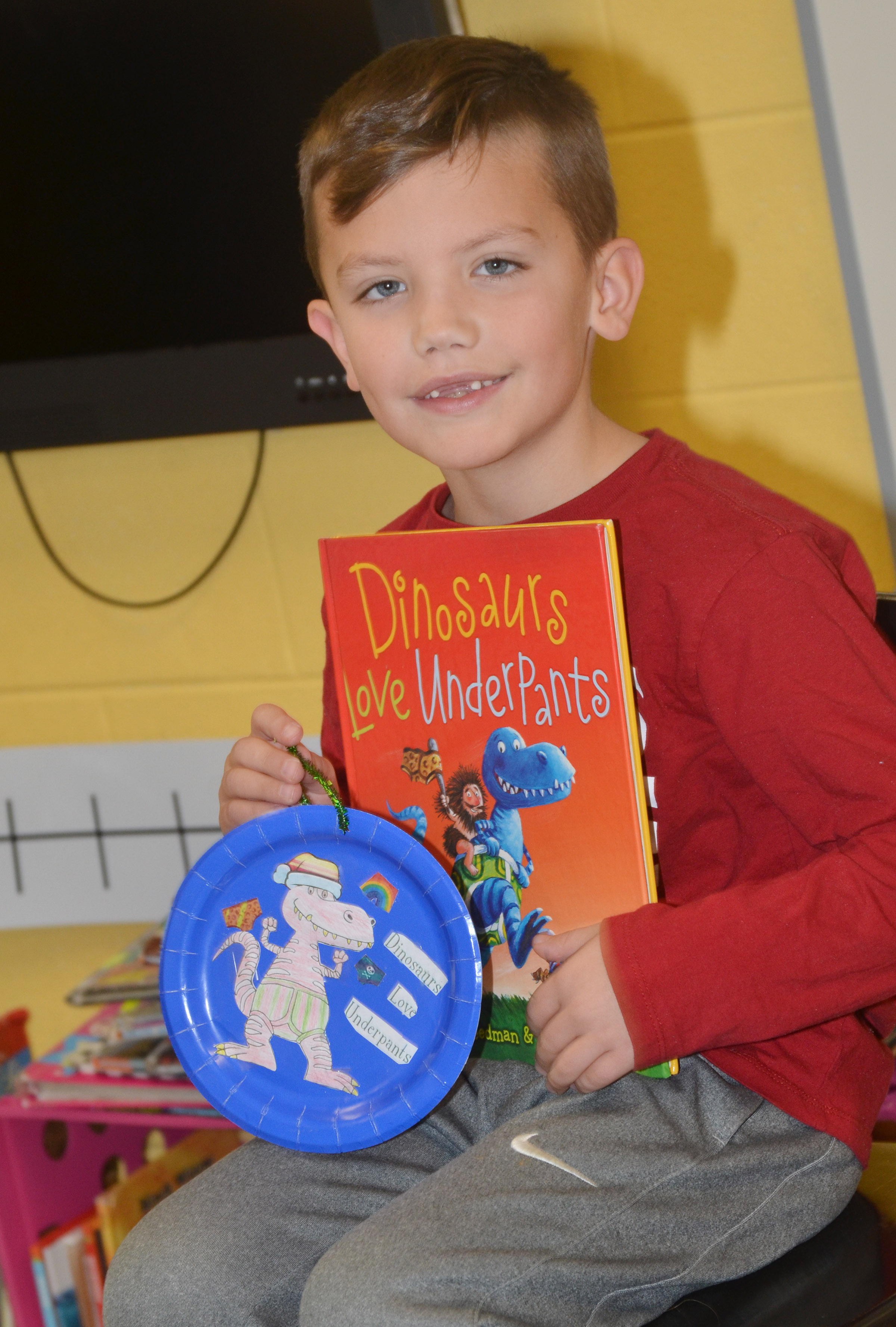 CES second-grader Owen Skaggs tells his classmates about his ornament.