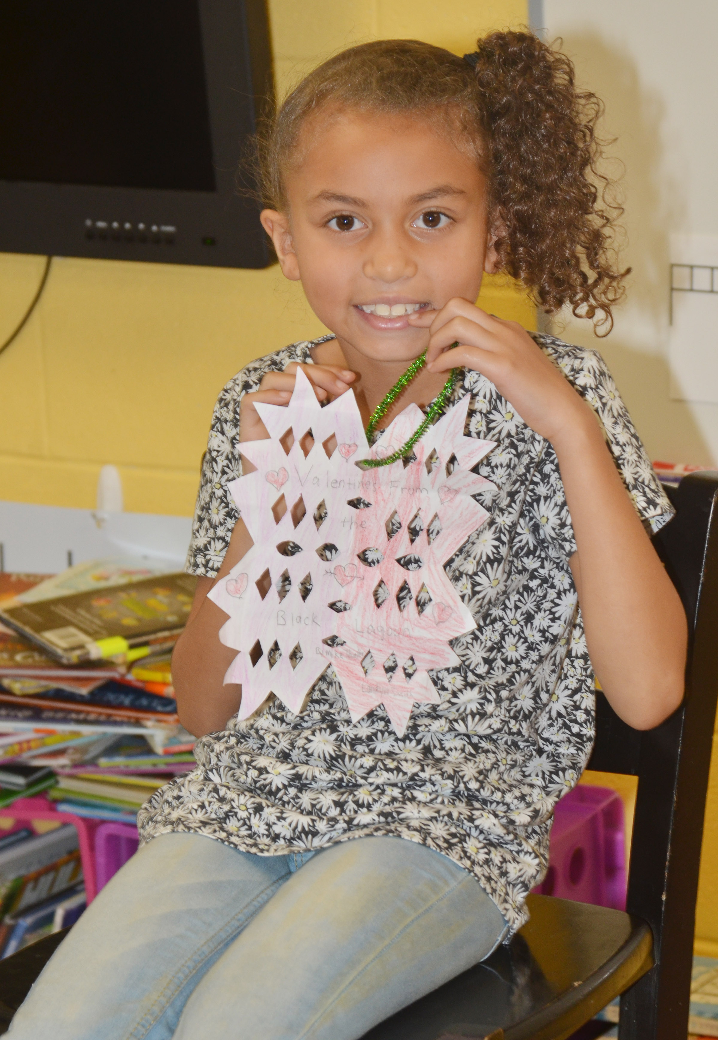 CES second-grader Londyn Smith tells her classmates about her ornament.