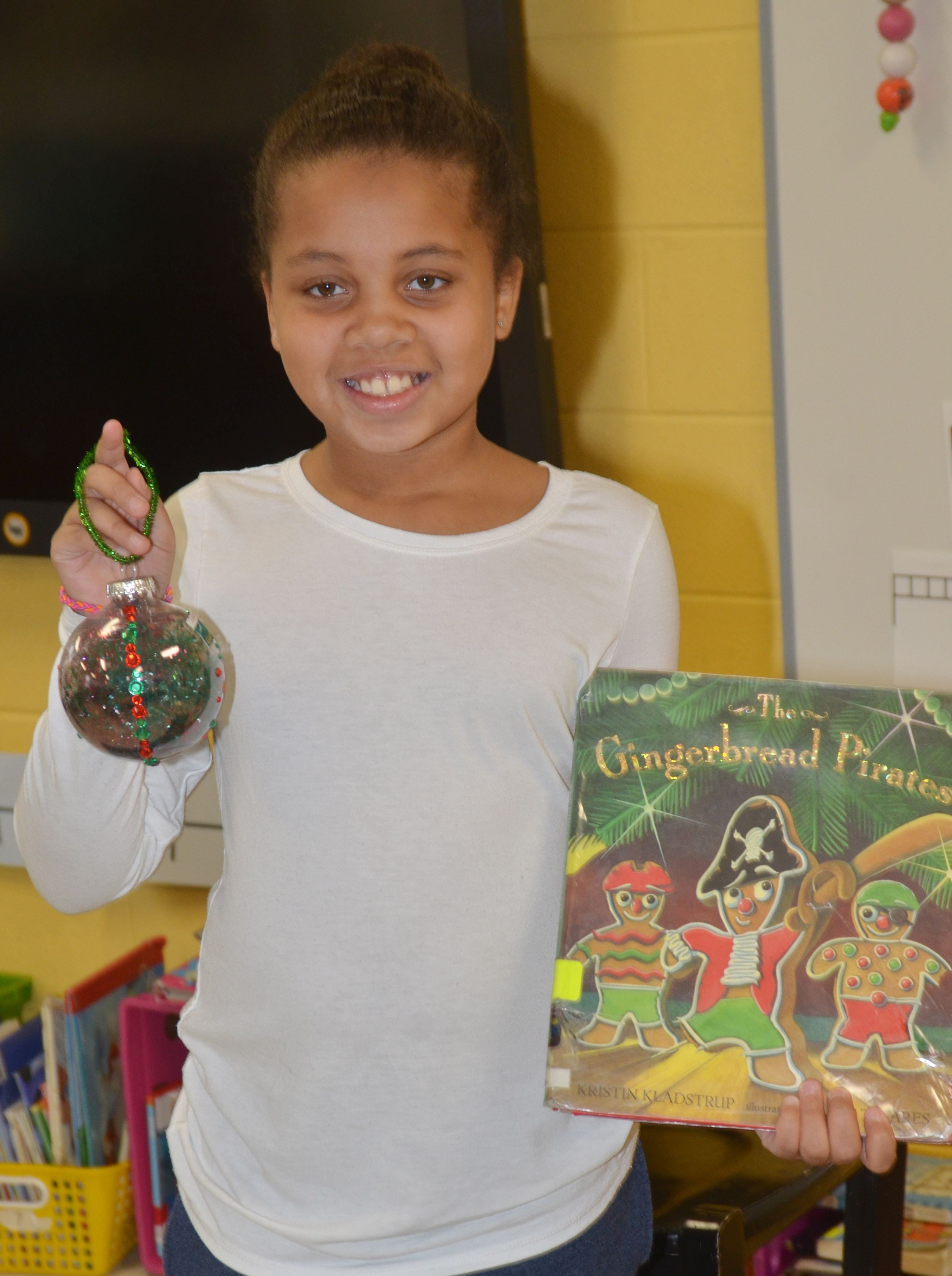 CES second-grader Journey Webb tells her classmates about her ornament.