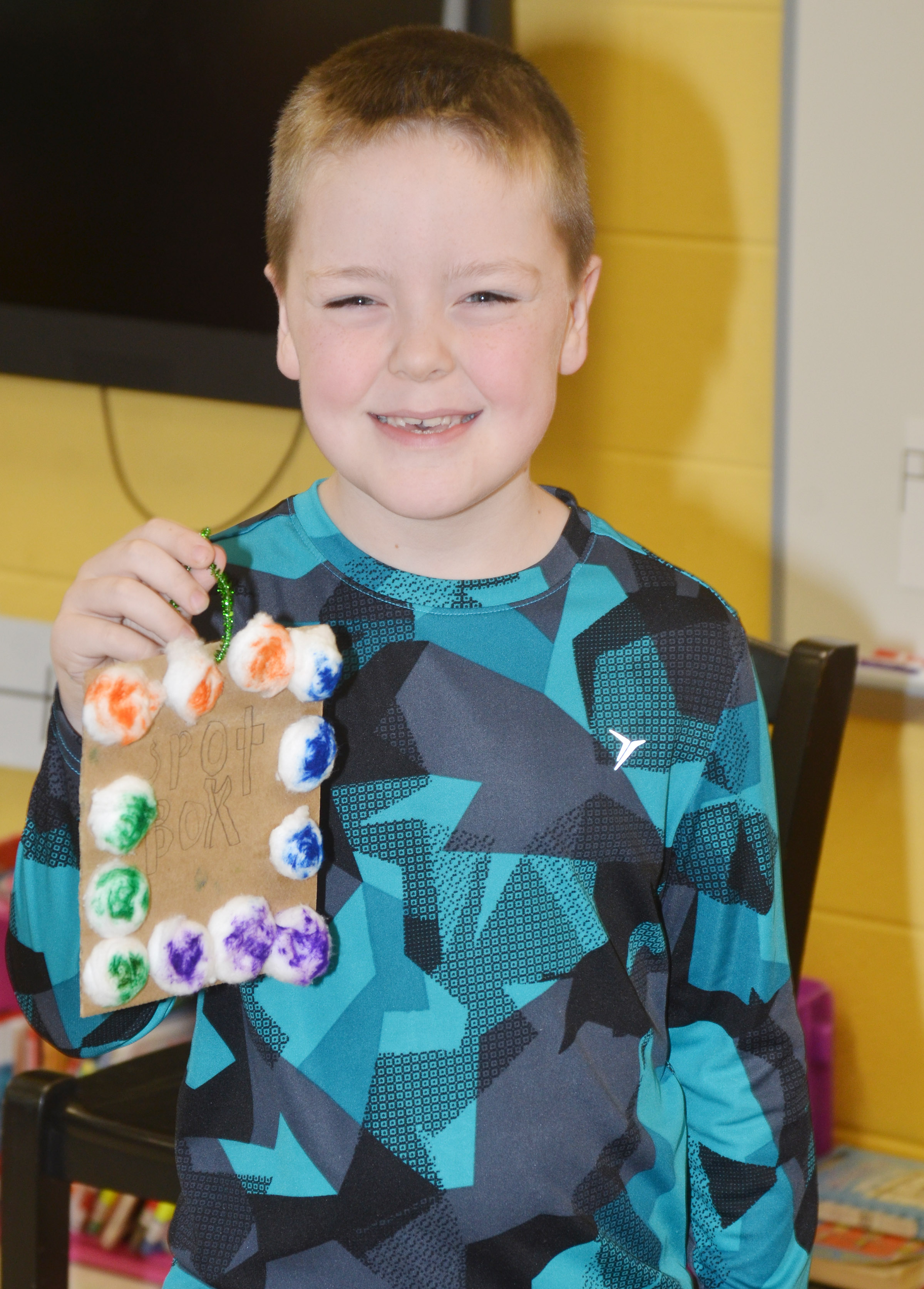 CES second-grader Eric Epperson tells his classmates about his ornament.