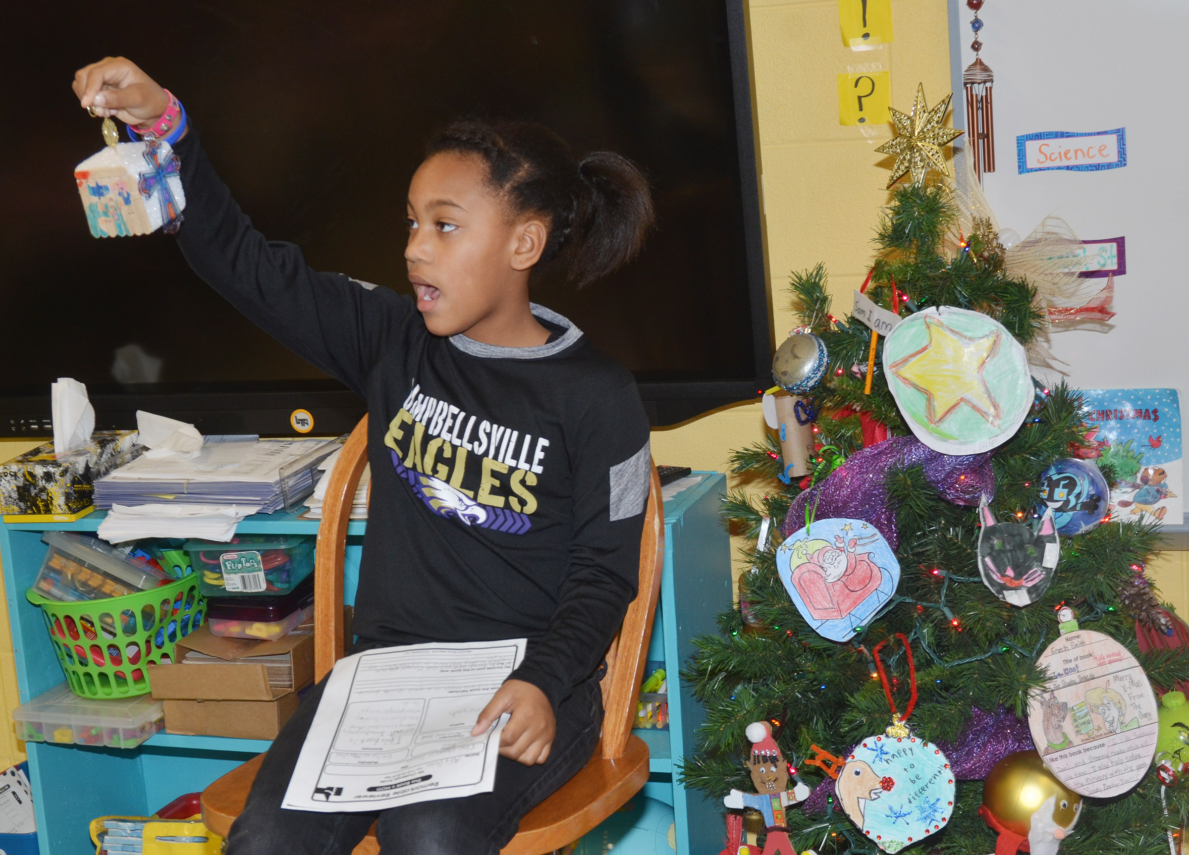 CES second-grader Aliy Dunn tells her classmates about her ornament.