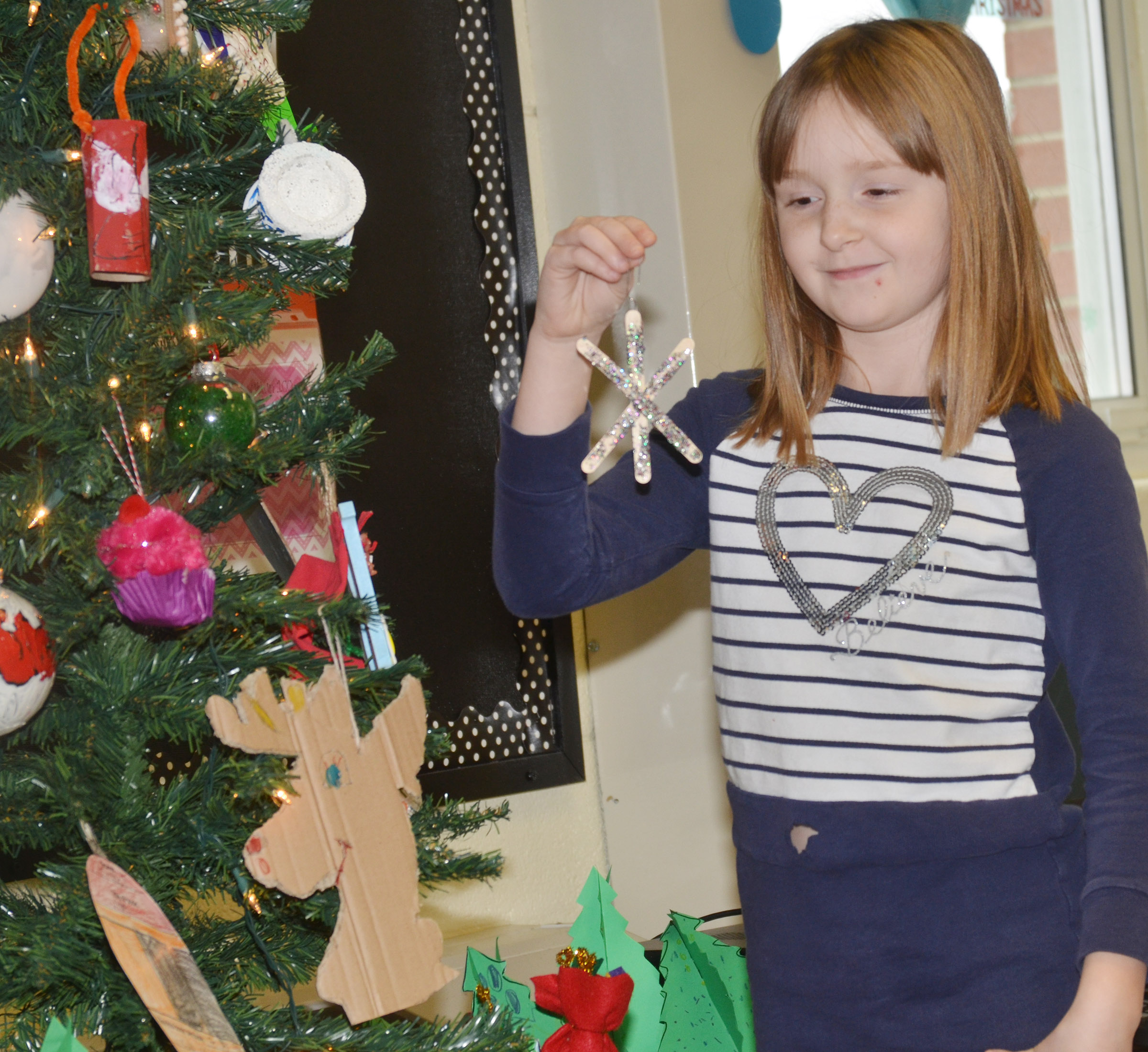 CES second-grader Gracie Murphy tells her classmates about her ornament.