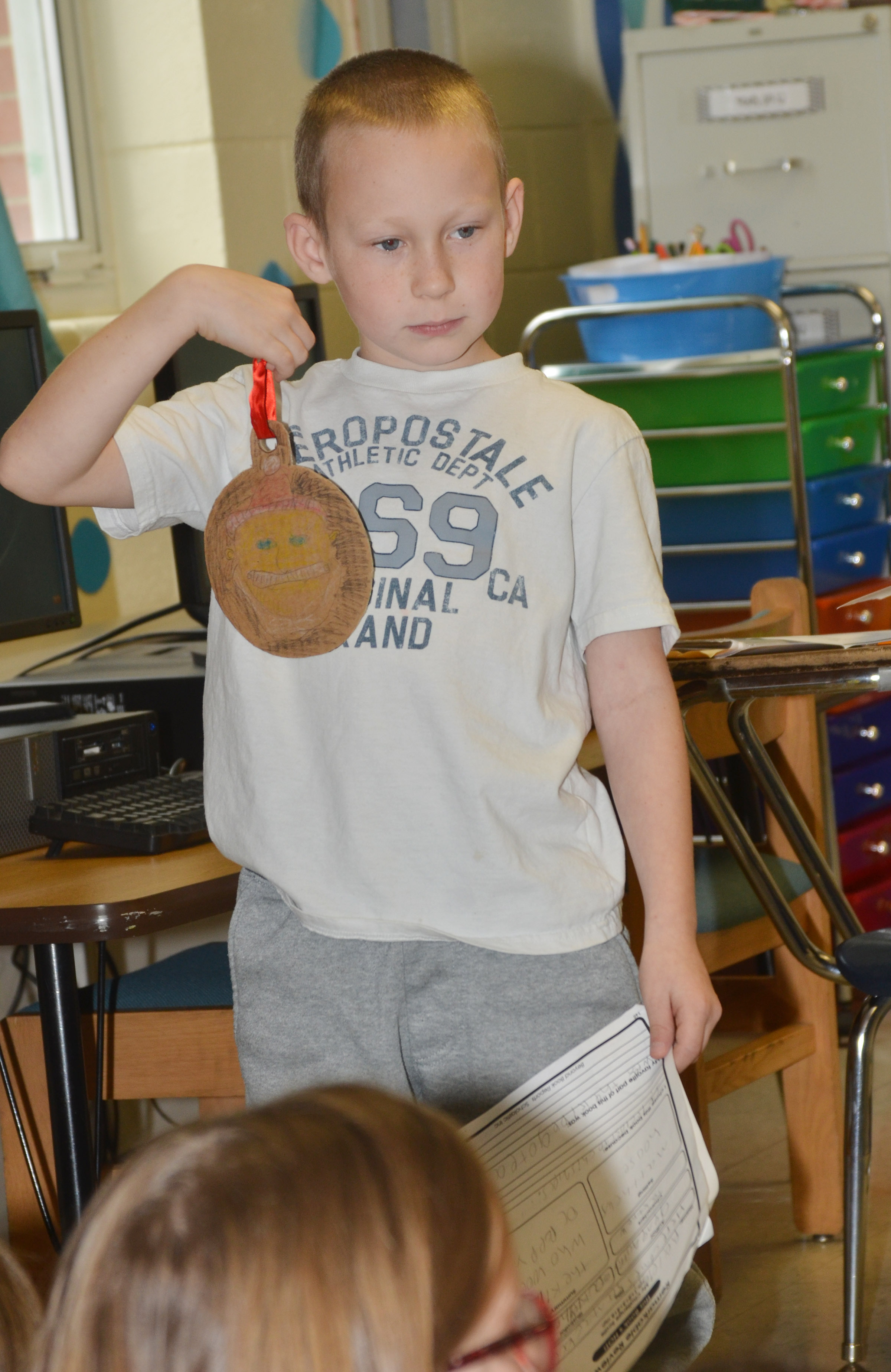 CES second-grader Raleigh Spencer tells his classmates about his ornament.